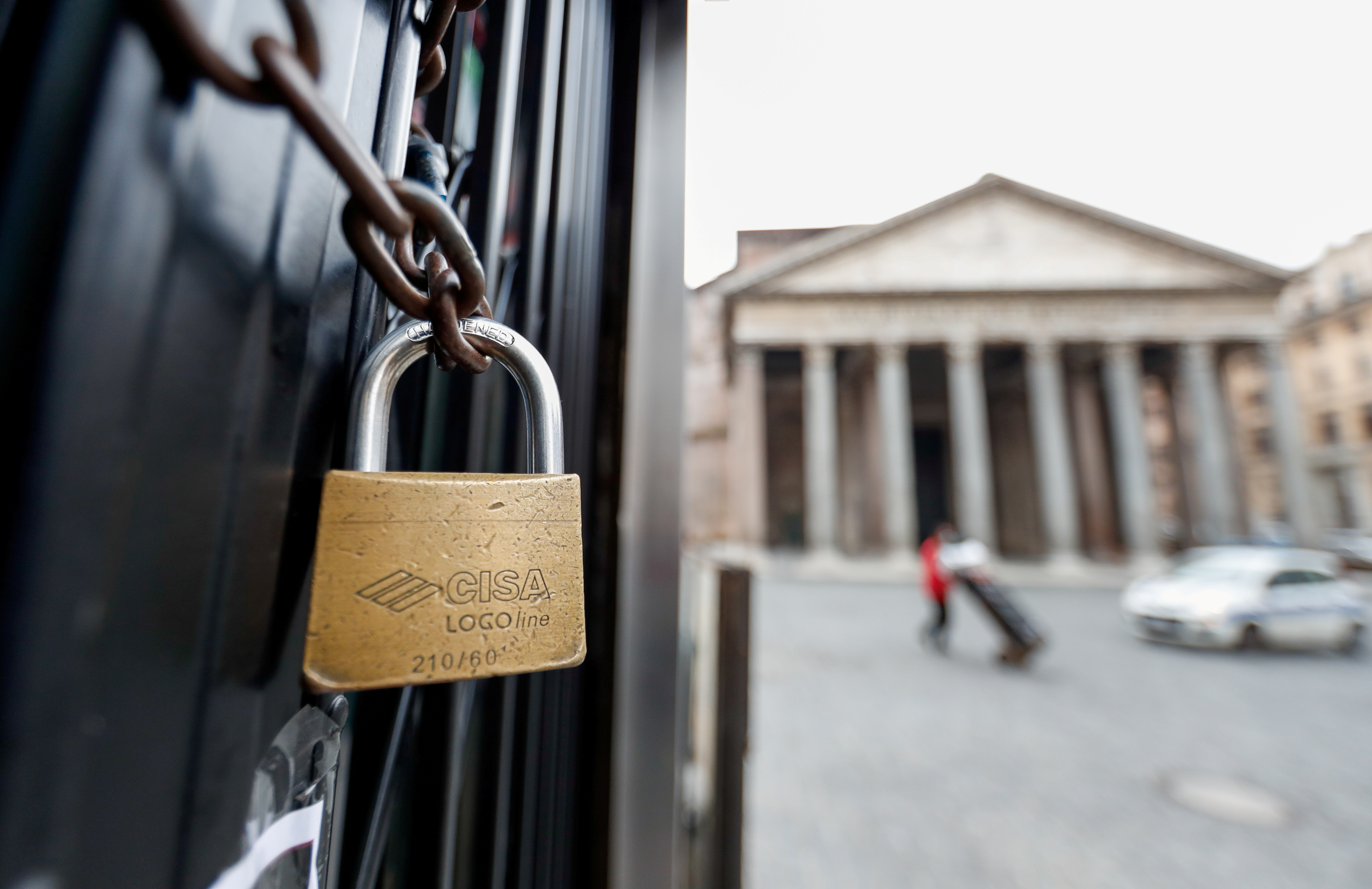 A padlock is seen on the door of a closed restaurant near the Pantheon, as the region enters the 'yellow zone' after the government relaxed some of the coronavirus disease (COVID-19) curbs on weekdays following a strict lockdown over the holidays, in Rome, Italy January 7, 2021. REUTERS/Yara Nardi