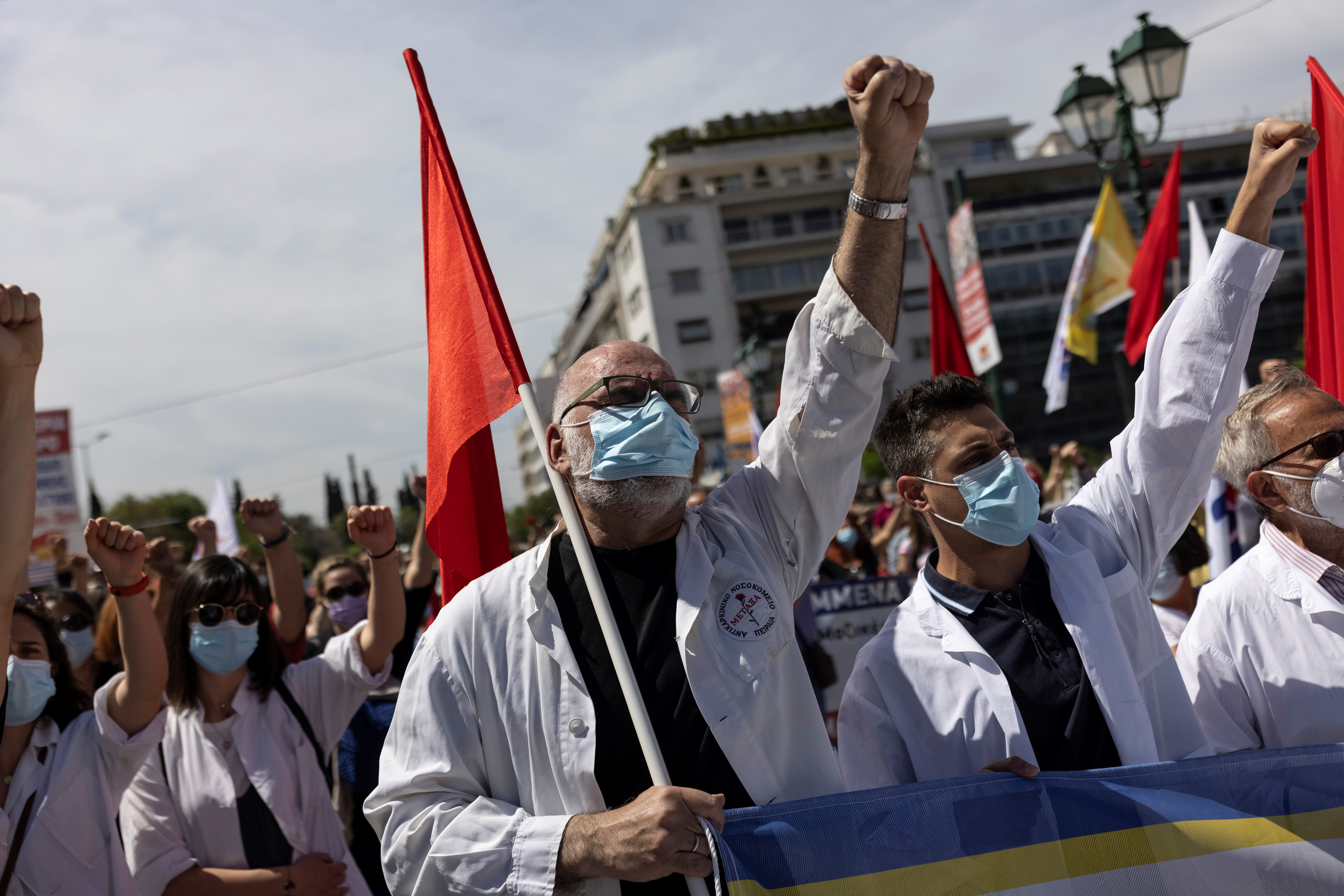 Medical workers wearing protective face masks against the spread of the coronavirus disease (COVID-19), shout slogans during a rally organised by the communist-affiliated trade union PAME commemorating May Day, in Athens, Greece, May 6, 2021. REUTERS/Alkis Konstantinidis
