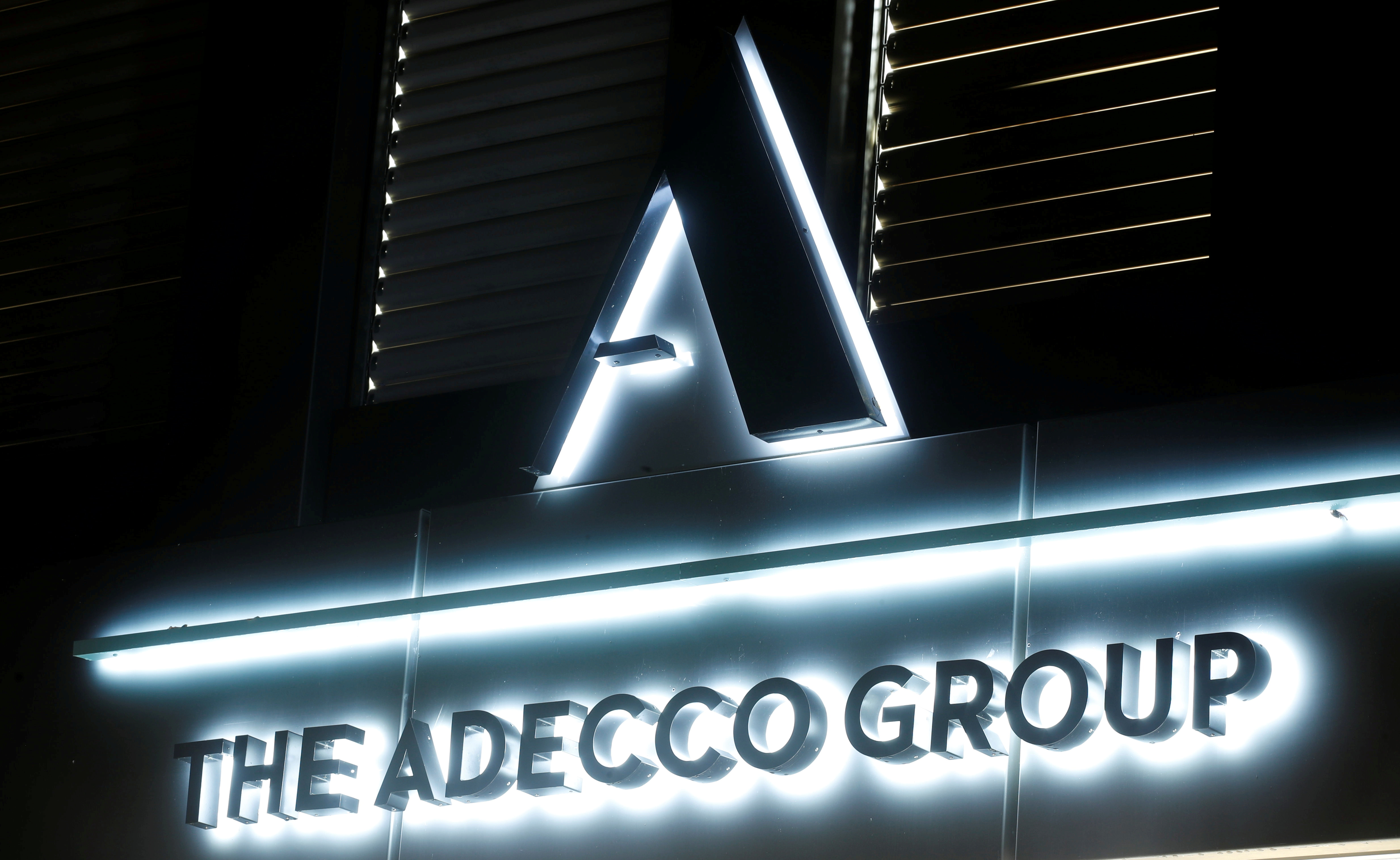 The logo of Swiss Adecco Group is seen at its headquarters in Zurich, Switzerland October 30, 2018. Picture taken October 30, 2018. REUTERS/Arnd Wiegmann/File Photo