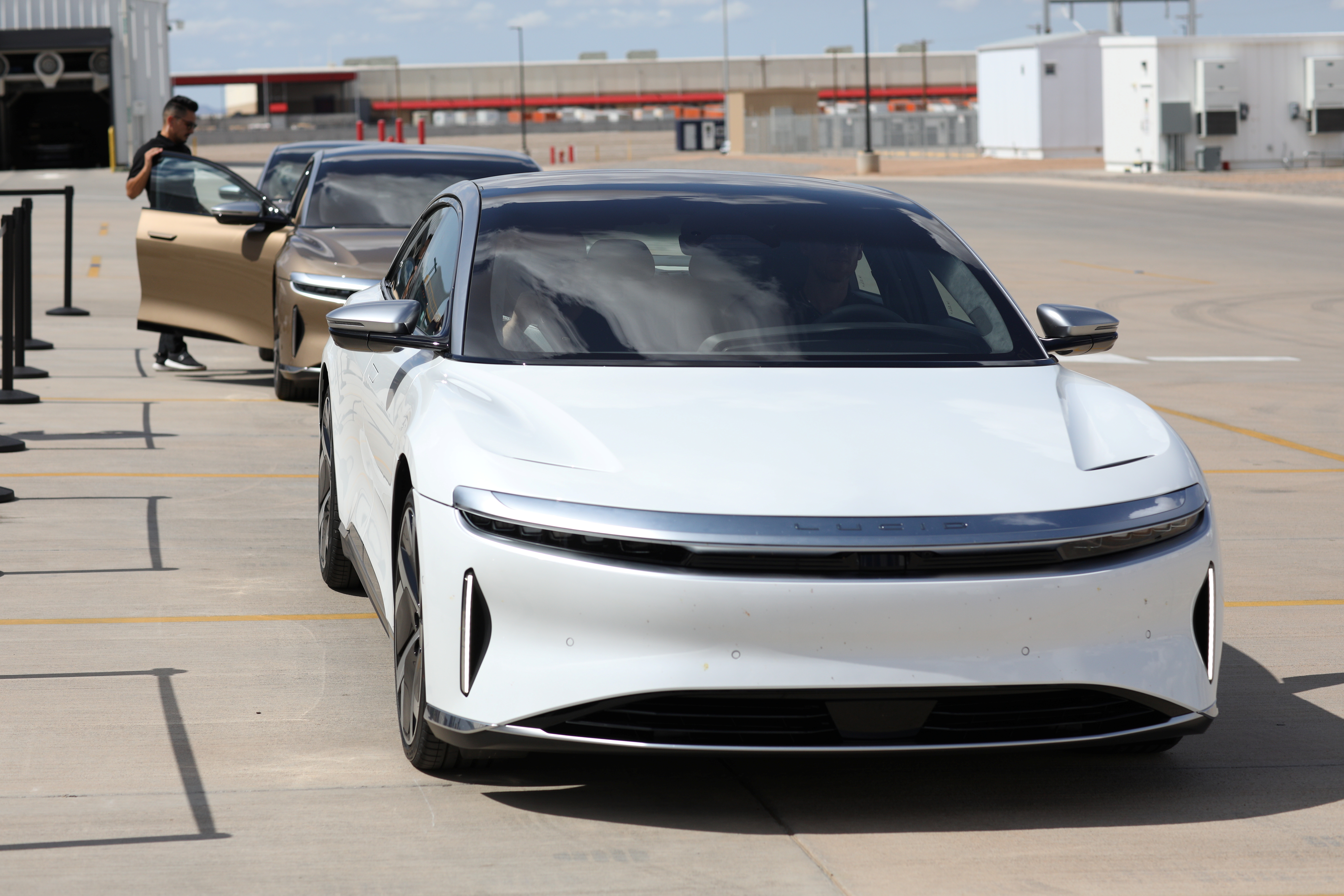 People test drive Dream Edition P and Dream Edition R electric vehicles at the Lucid Motors plant in Casa Grande, Arizona, U.S. September 28, 2021. REUTERS/Caitlin O'Hara