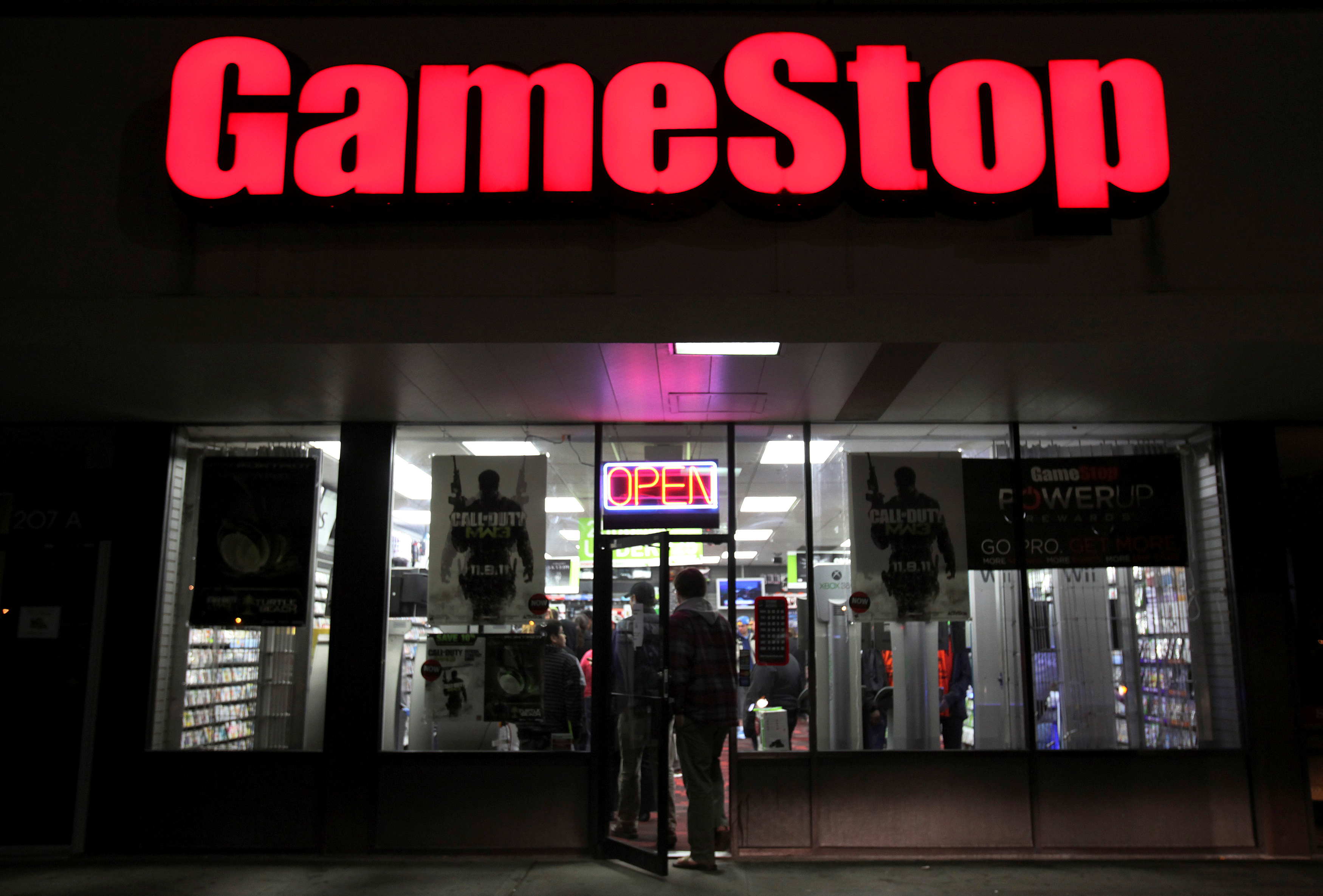 People enter a GameStop store during