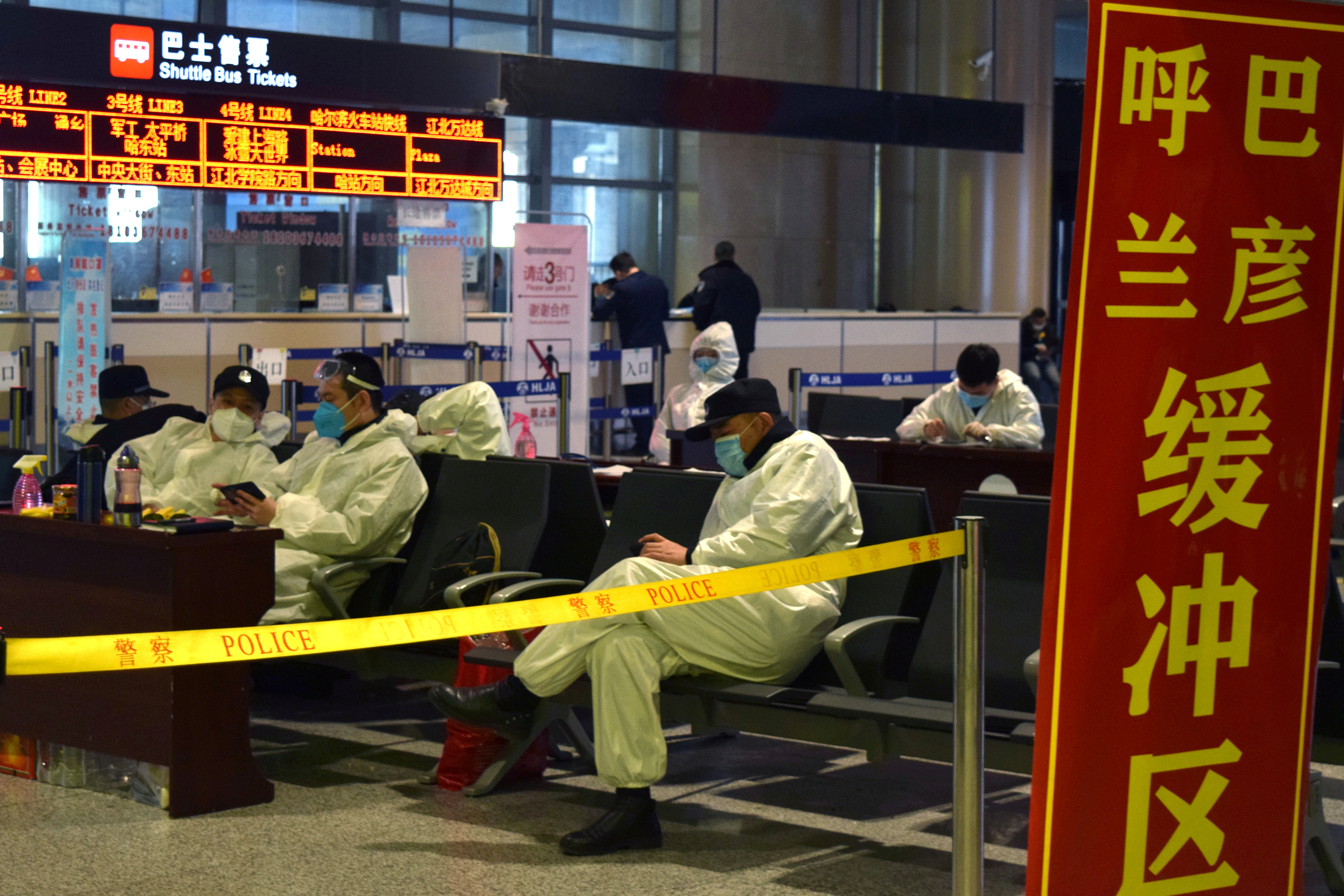 Police officers in protective suits are seen at an airport in Harbin, capital of Heilongjiang province bordering Russia, following the spread of the novel coronavirus disease (COVID-19) continues in the country, China April 11, 2020. REUTERS/Huizhong Wu/Files