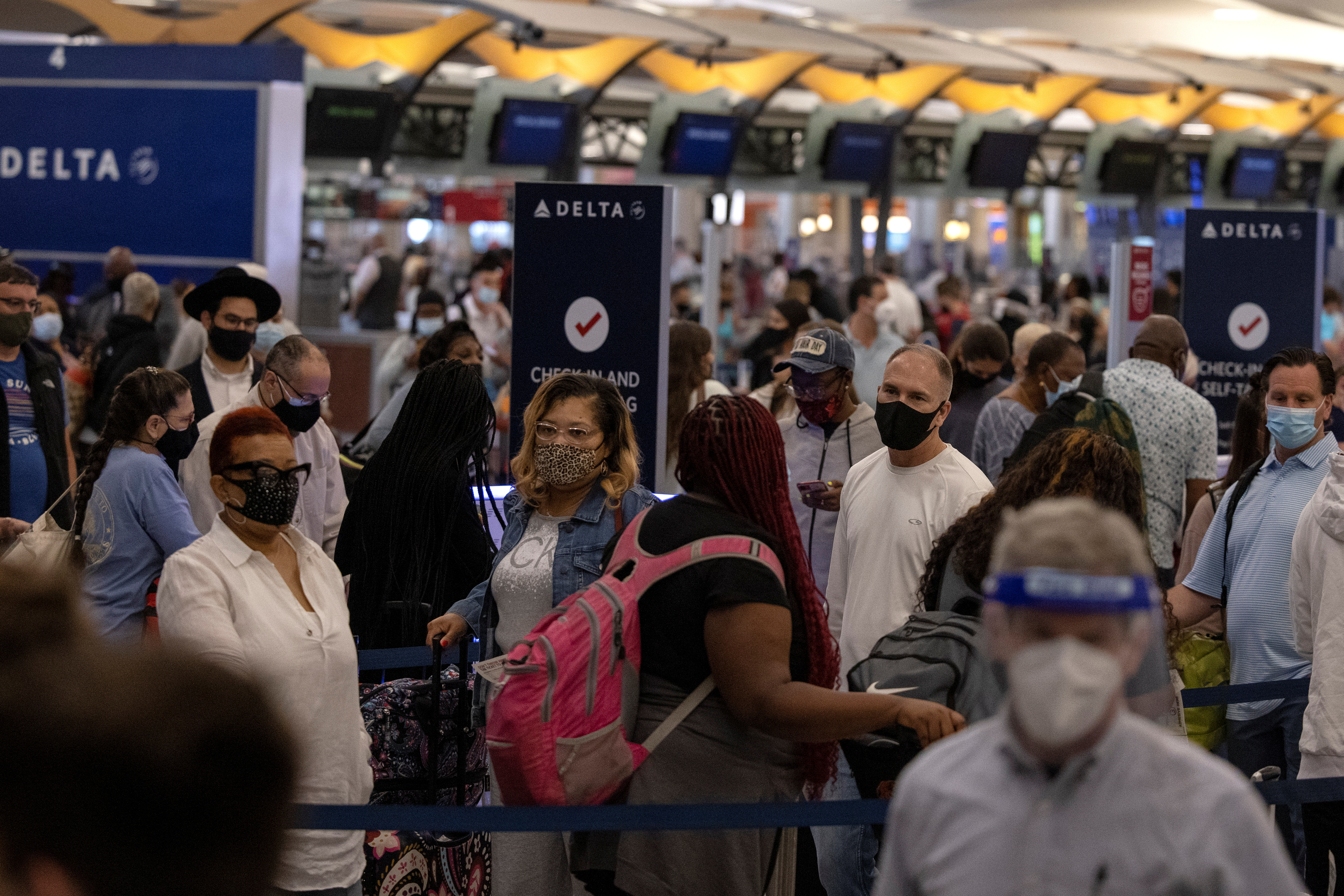 Passengers gather near Delta airline's counter as they check-in their luggage at Hartsfield-Jackson Atlanta International Airport, in Atlanta, Georgia, U.S., May 23, 2021.  REUTERS/Carlos Barria