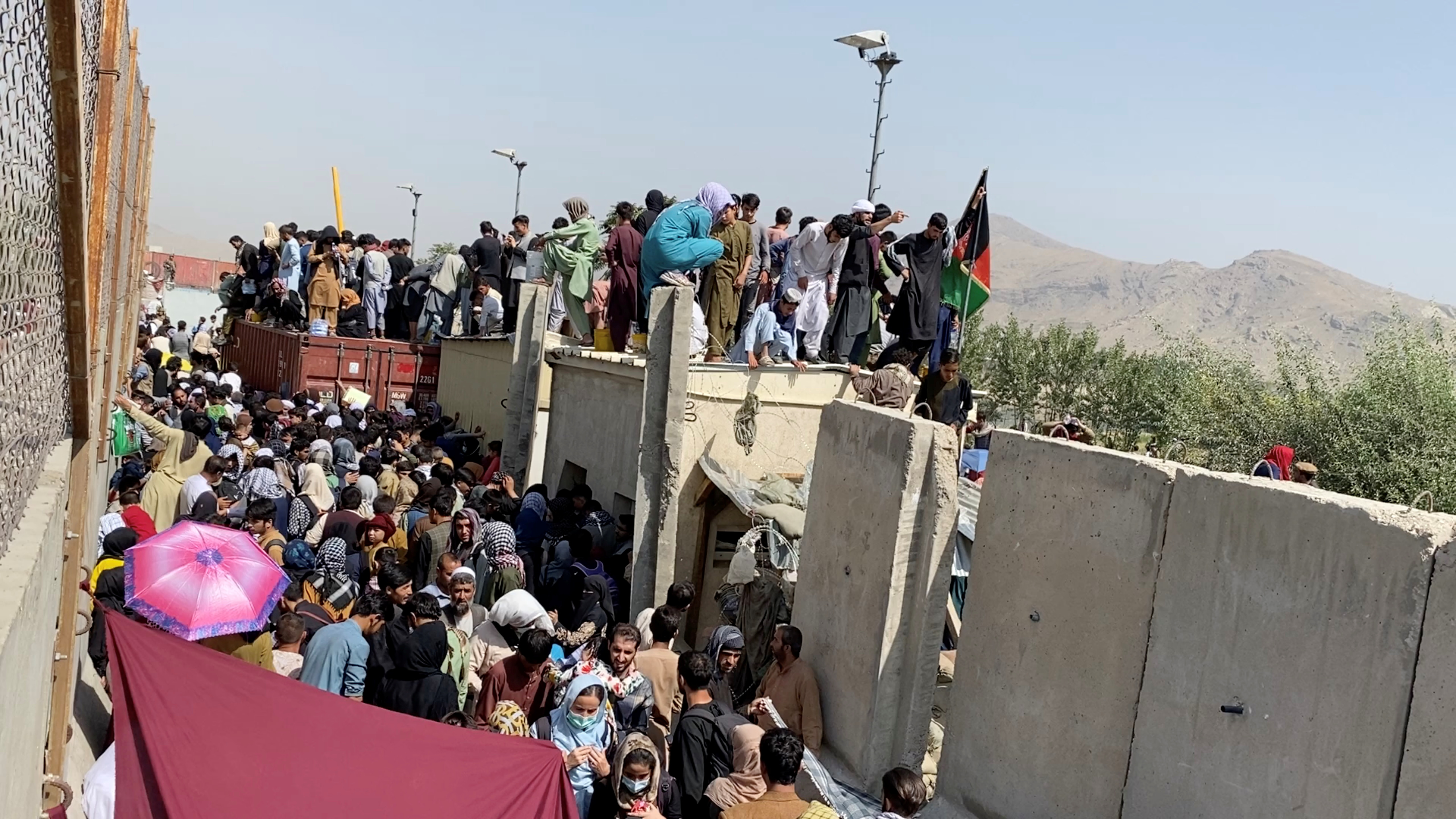 A still image taken from video shows crowds of people near the airport in Kabul, August 23, 2021. ASVAKA NEWS via REUTERS