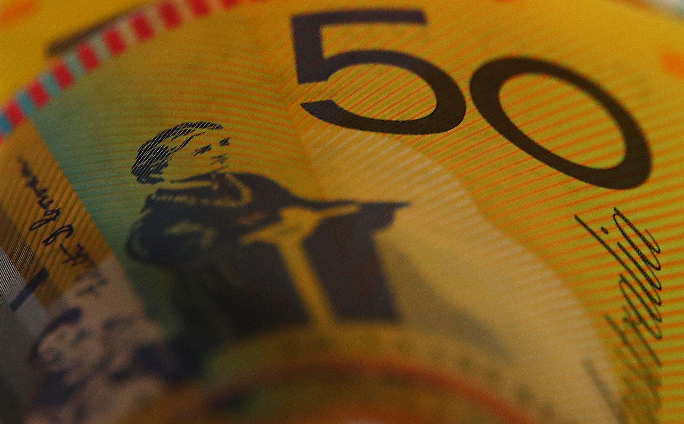 Australian dollars are seen in an illustration photo February 8, 2018. REUTERS/Daniel Munoz