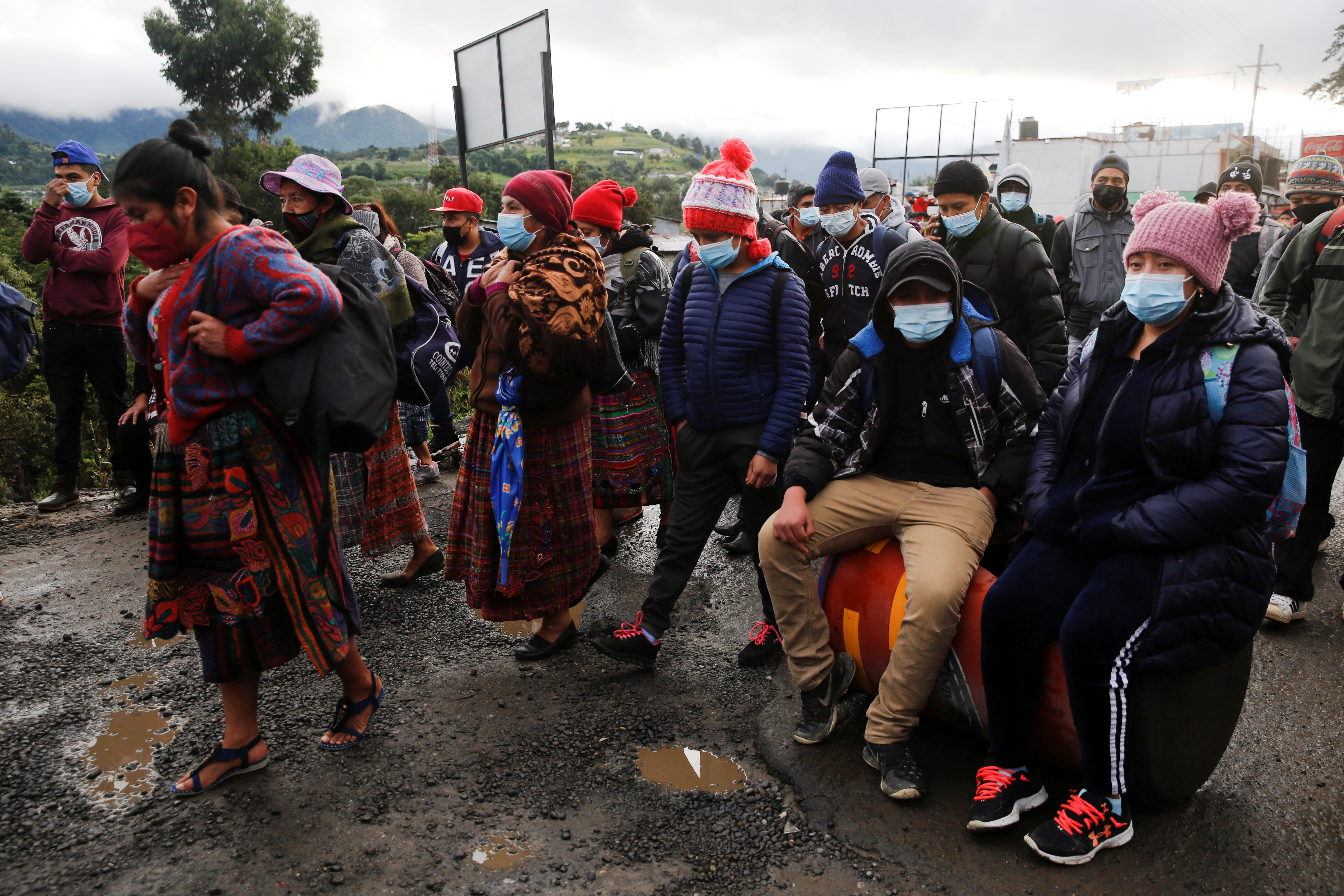 Mayan indigenous people block a road as they take part in a protest demanding the resignation of Guatemalan President Alejandro Giammattei and Attorney General Maria Porras, in San Cristobal Totonicapan, Guatemala July 29, 2021. REUTERS/Luis Echeverria