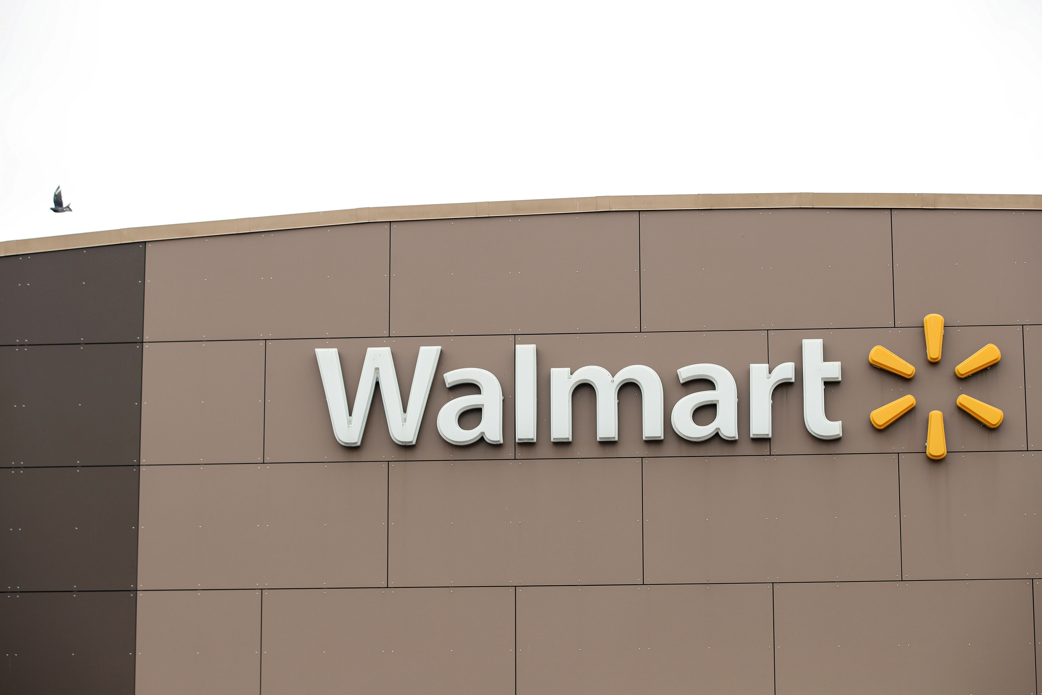 Walmart's logo is seen outside one of the stores ahead of the Thanksgiving holiday in Chicago, Illinois, U.S. November 27, 2019. REUTERS/Kamil Krzaczynski/File Photo