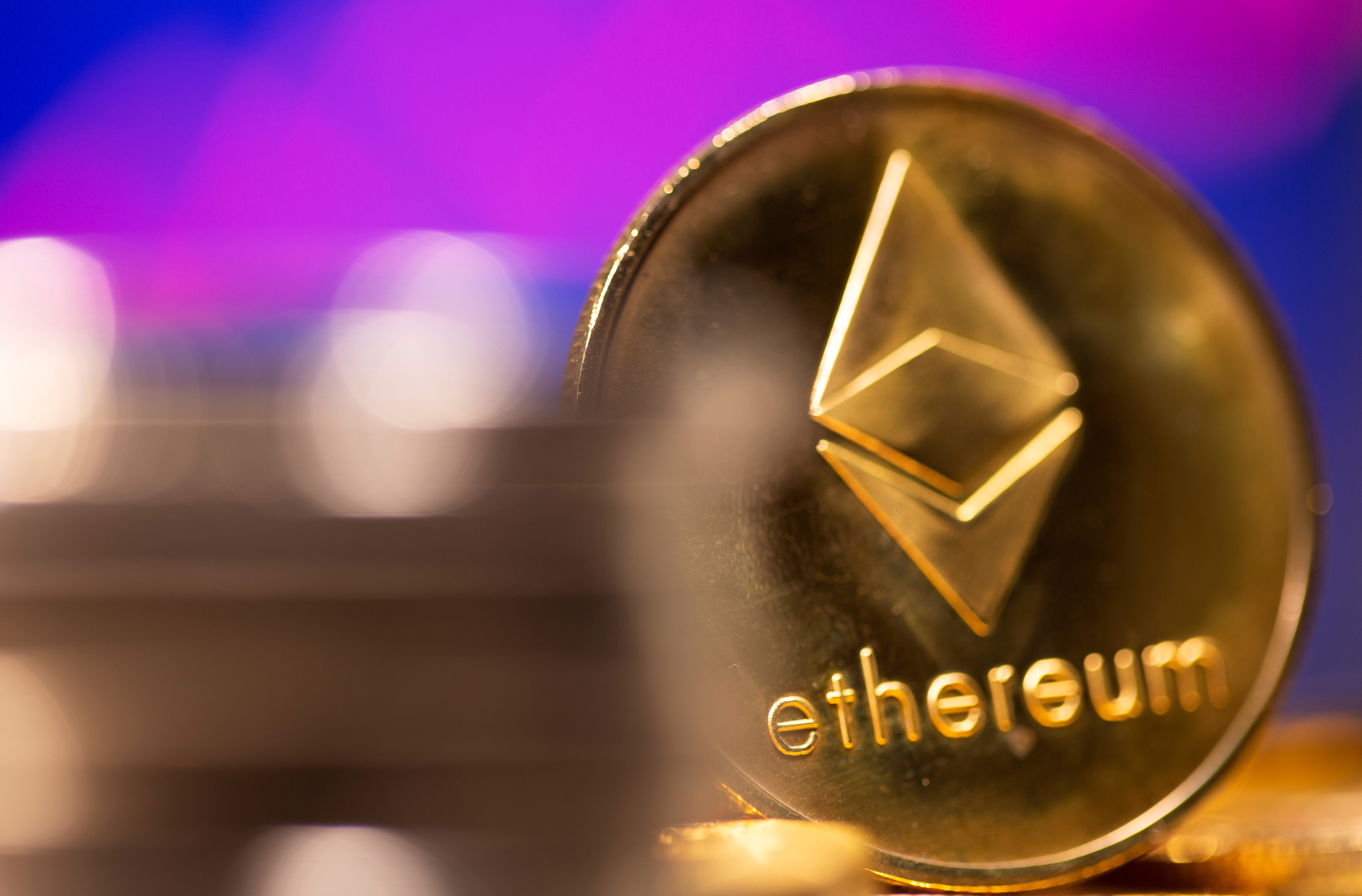 A representation of virtual currency Ethereum is seen in front of a stock graph in this illustration taken February 19, 2021. REUTERS/Dado Ruvic/Illustration/File Photo