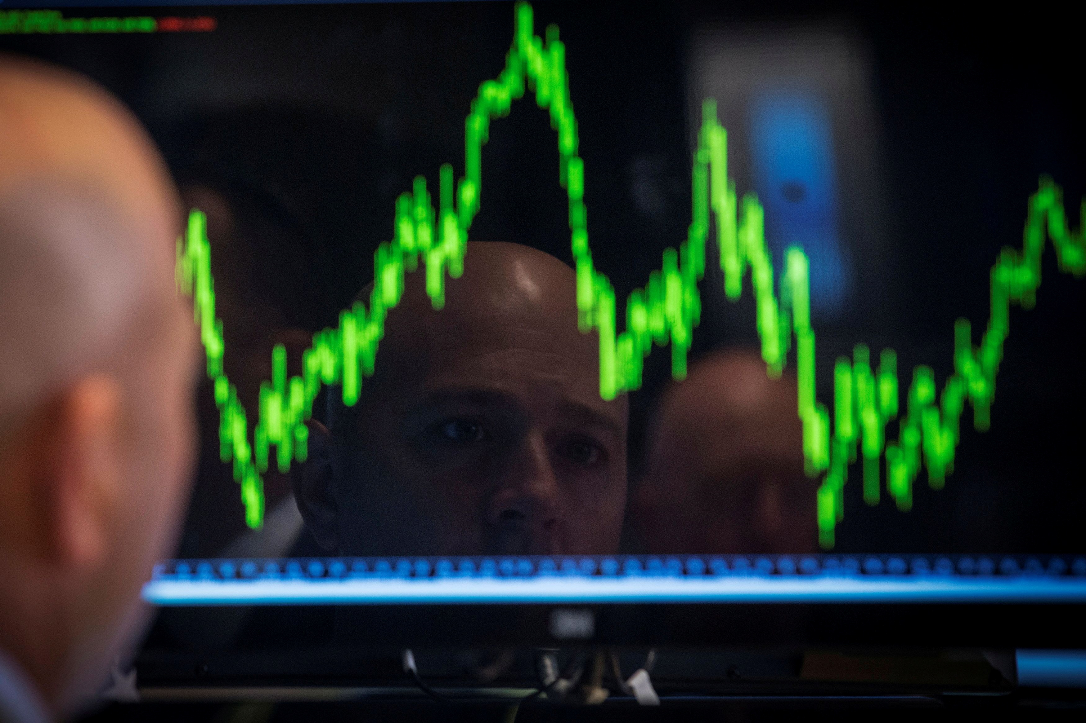 A Specialist trader watches his chart while working on the floor of the New York Stock Exchange July 8, 2014.     REUTERS/Brendan McDermid/File Photo