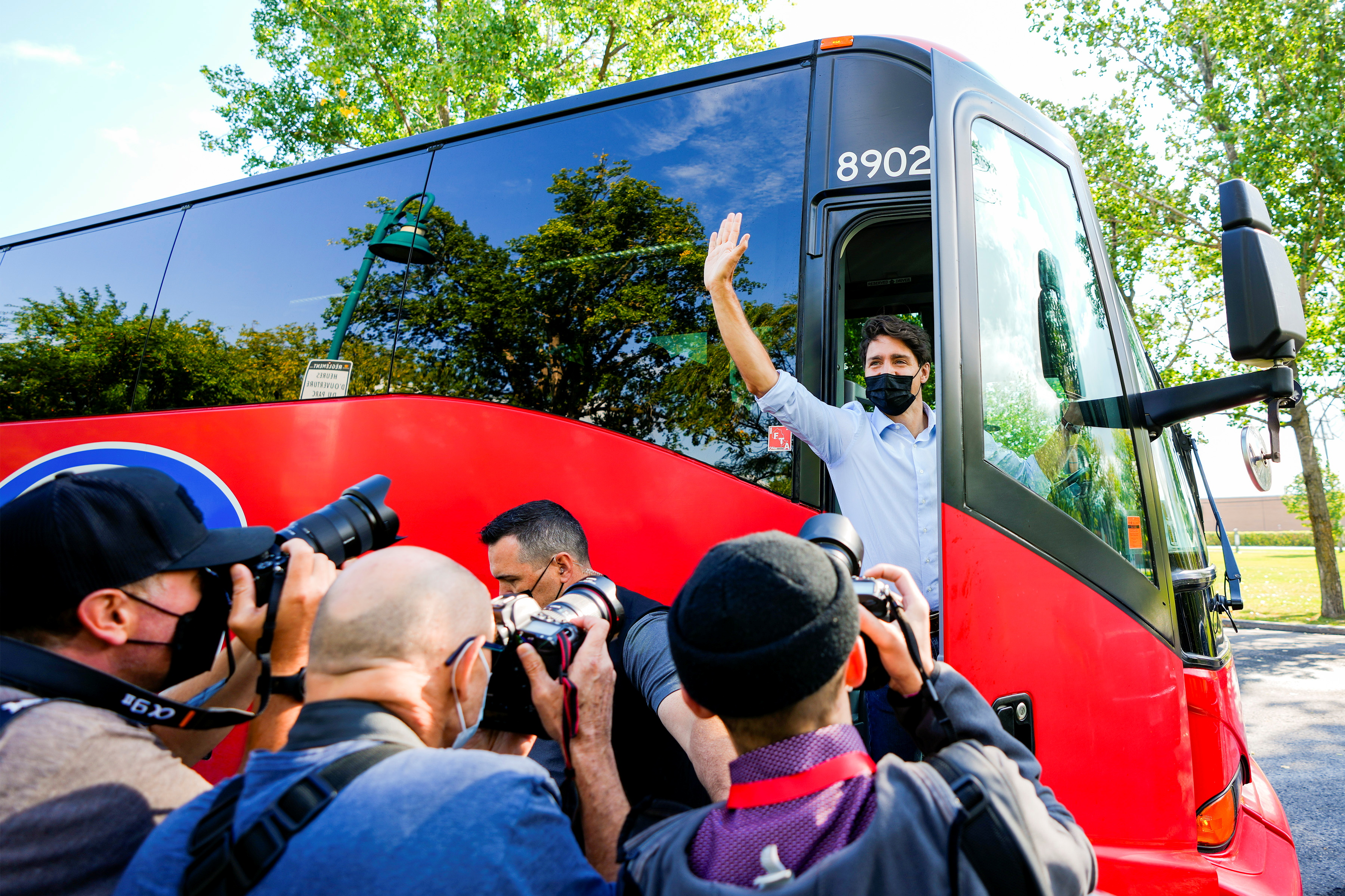 Canada's Prime Minister Justin Trudeau waves from his bus after his election campaign tour in Candiac, Quebec Canada, September 12, 2021. REUTERS/Carlos Osorio