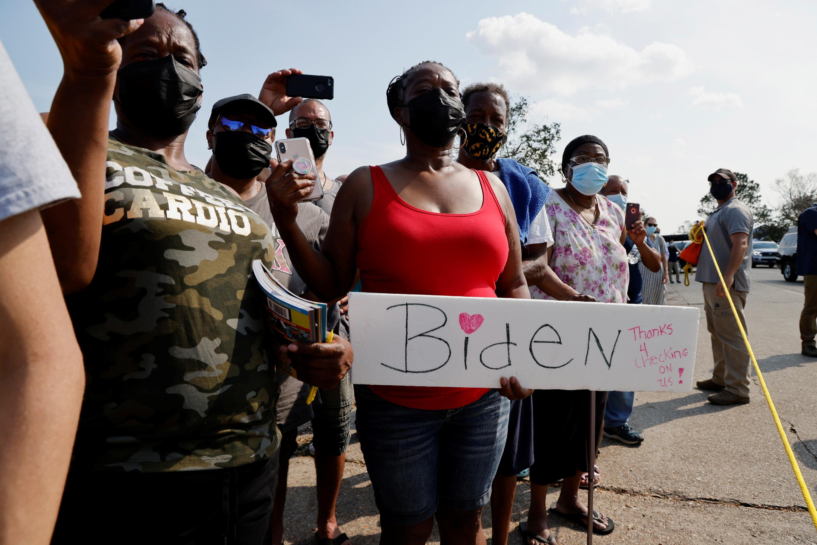 Local residents welcome U.S. President Joe Biden as he tours a neighbourhood hit by Hurricane Ida in LaPlace, Louisiana, U.S. September 3, 2021. REUTERS/Jonathan Ernst