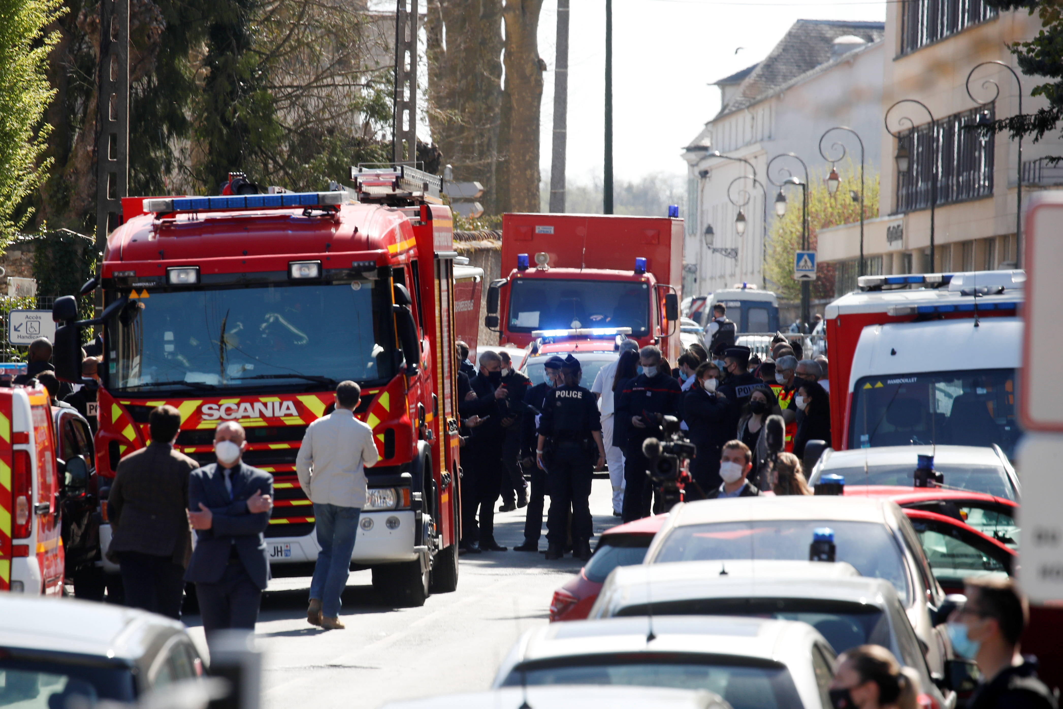 Police officers secure the area where an attacker stabbed a female police administrative worker, in Rambouillet, near Paris, France, April 23, 2021. REUTERS/Gonzalo Fuentes