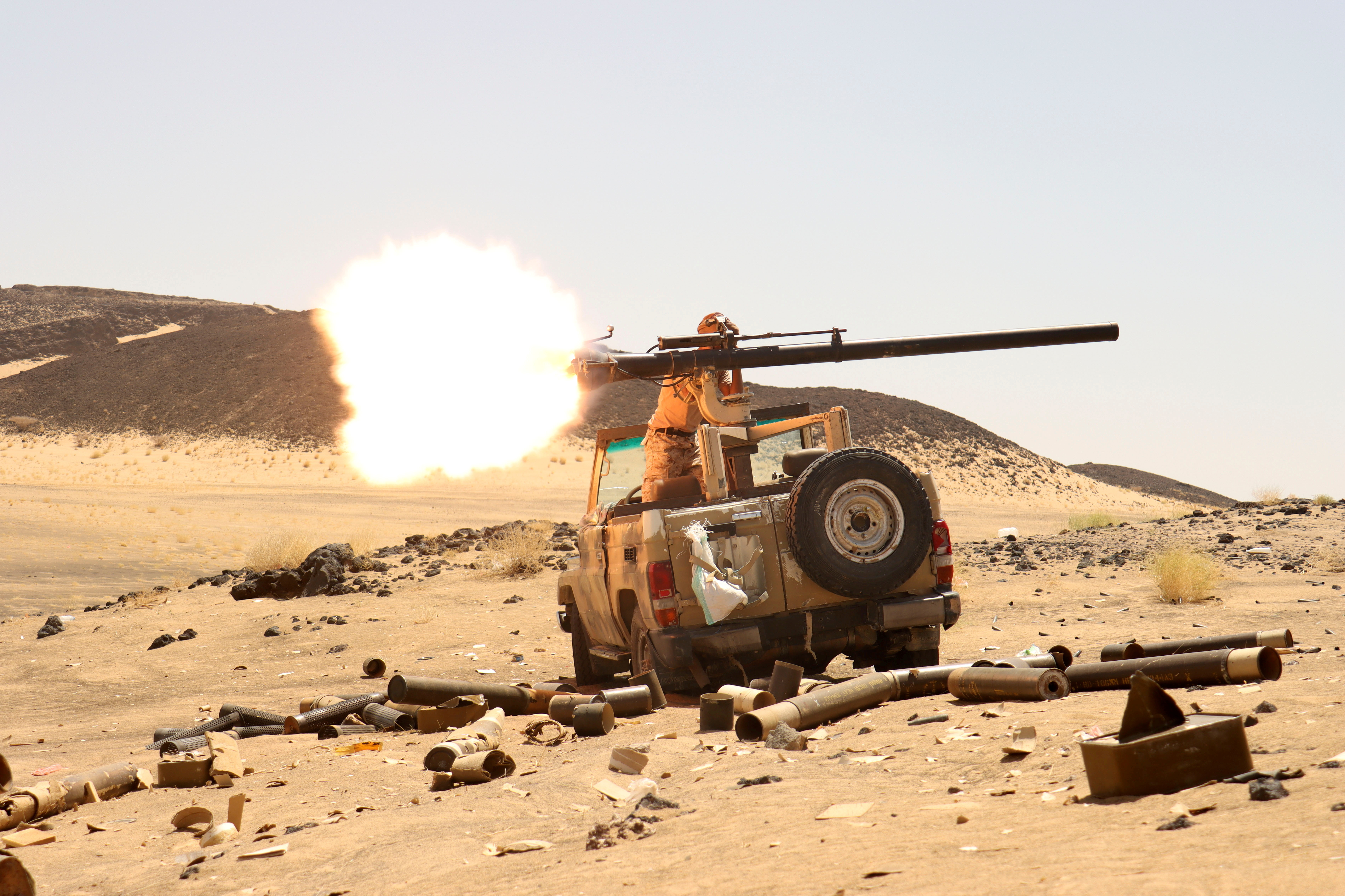 A Yemeni government fighter fires a vehicle-mounted weapon at a frontline position during fighting against Houthi fighters in Marib, Yemen March 9, 2021. REUTERS/Ali Owidha