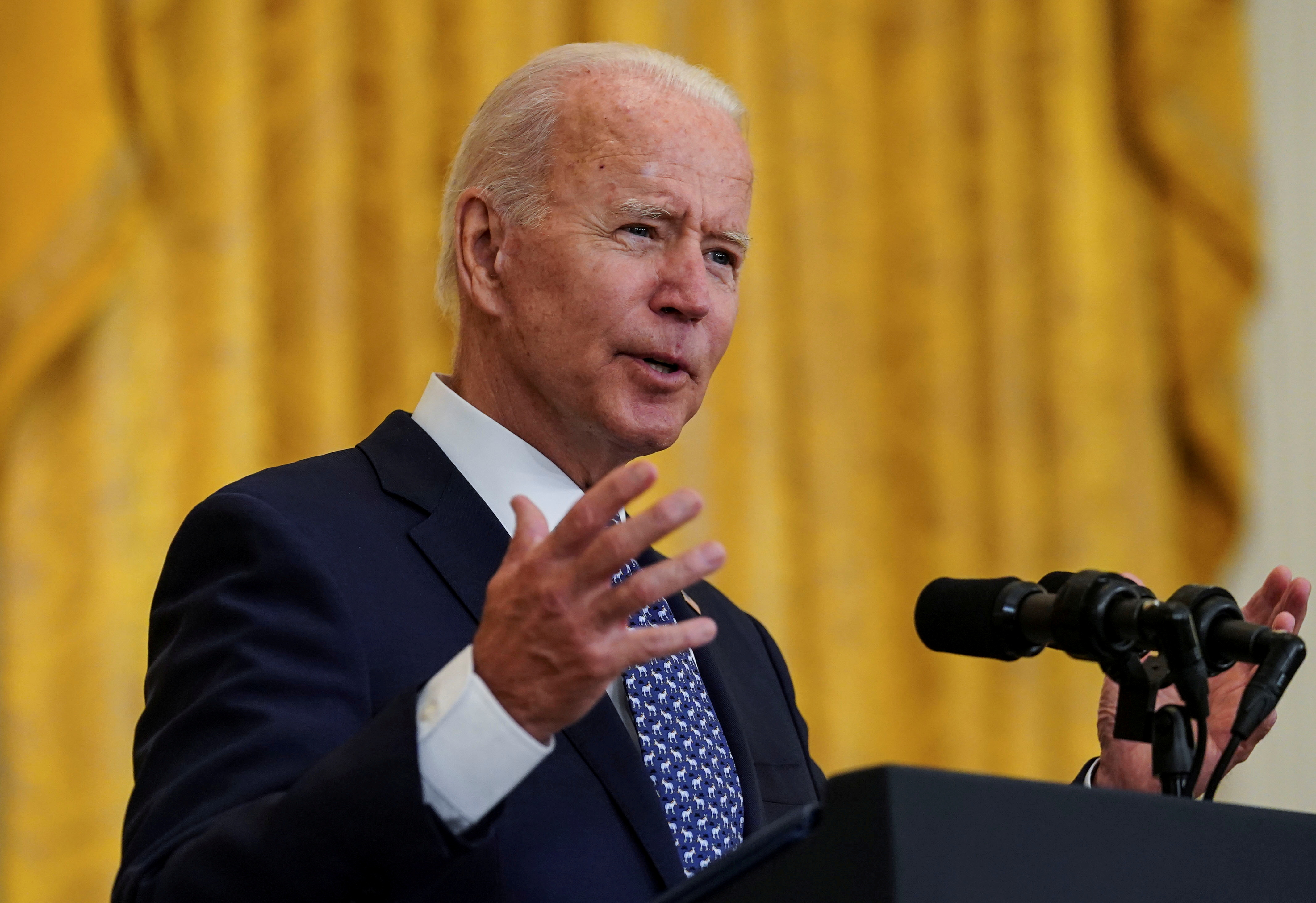 U.S. President Joe Biden delivers remarks in honor of labor unions in the East Room at the White House in Washington, U.S., September 8, 2021. REUTERS/Kevin Lamarque/File Photo