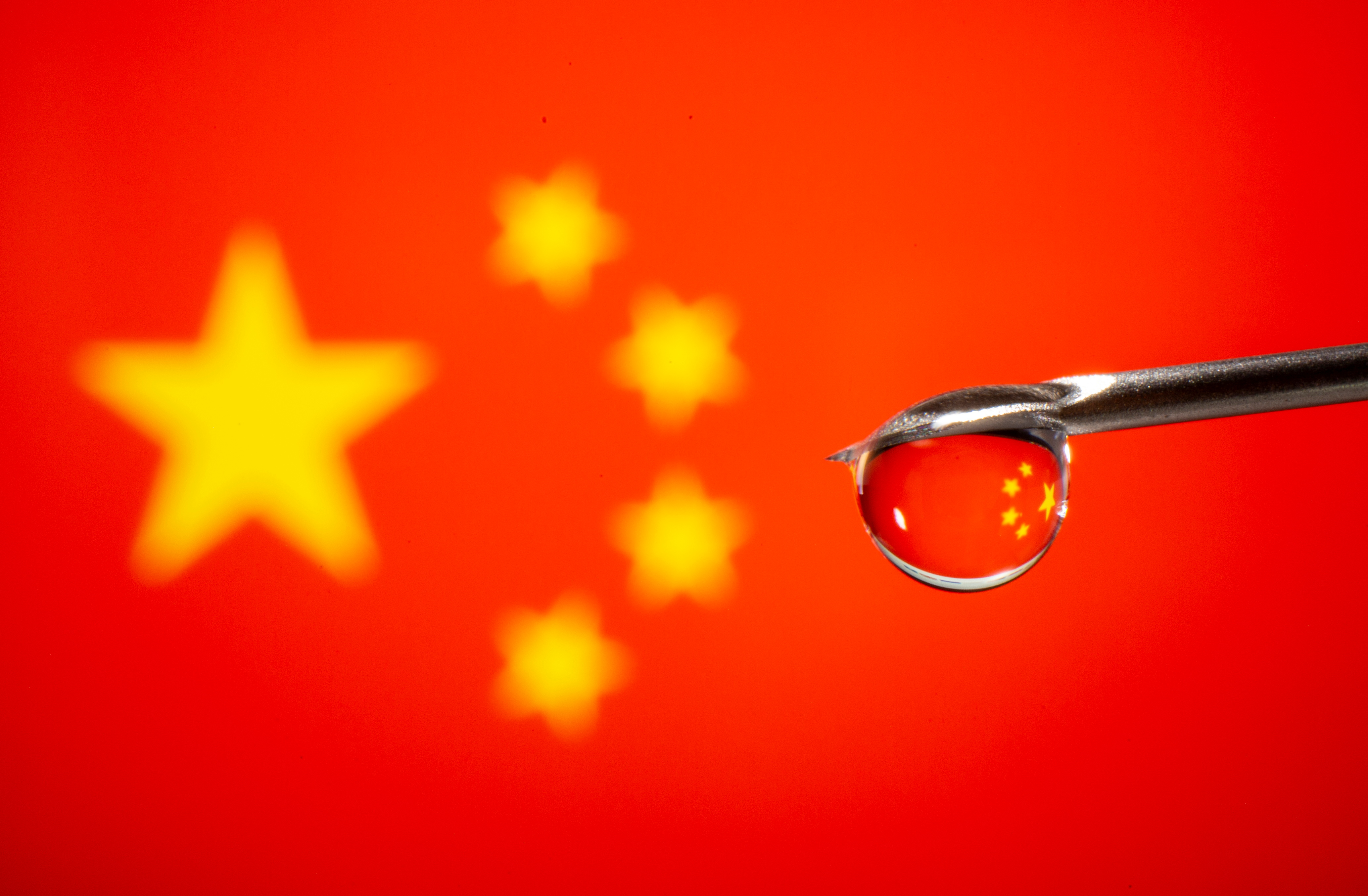 China's flag is reflected in a drop on a syringe needle in this illustration taken November 9, 2020. REUTERS/Dado Ruvic/Illustration