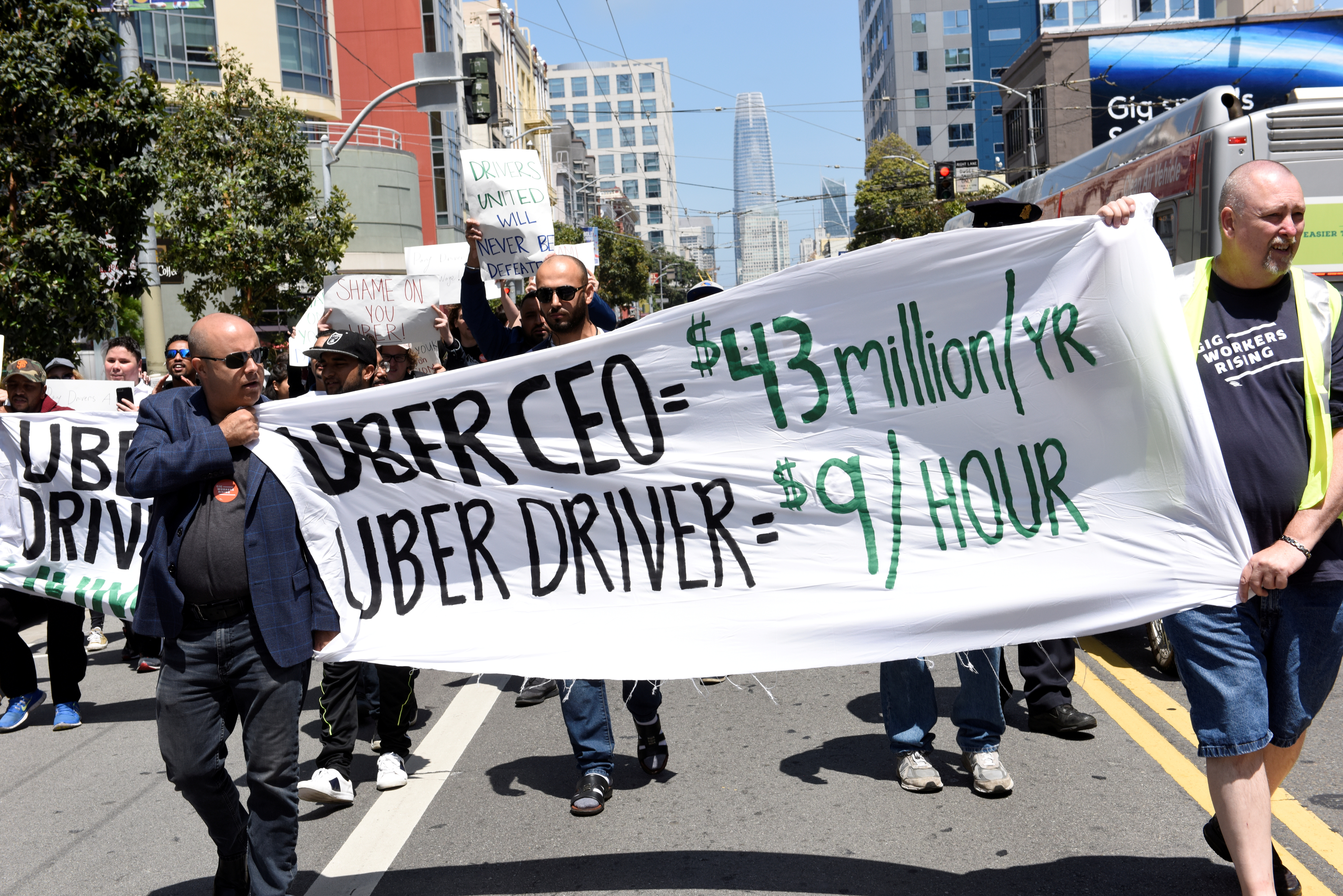 Protestors march through the financial district, demanding fair wages and more transparency during a strike against Uber in San Francisco, California, U.S., May 8, 2019.   REUTERS/Kate Munsch - RC1627733800/File Photo