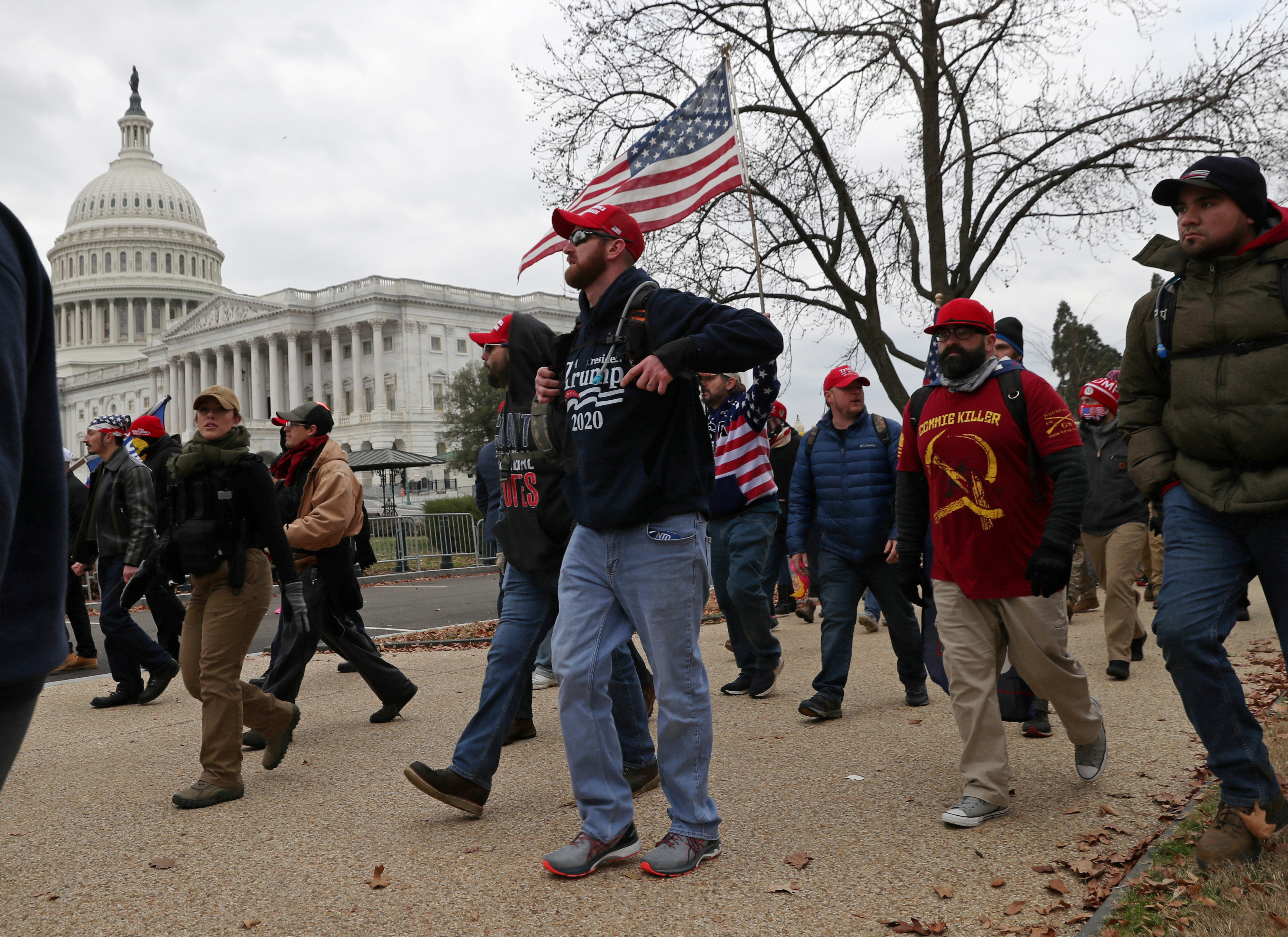 Members of the Proud Boys and supporters of U.S. President Donald Trump show up at the U.S. Capitol Building over an hour before supporters began to storm the building in Washington, U.S., January 6, 2021.  REUTERS/Leah Millis