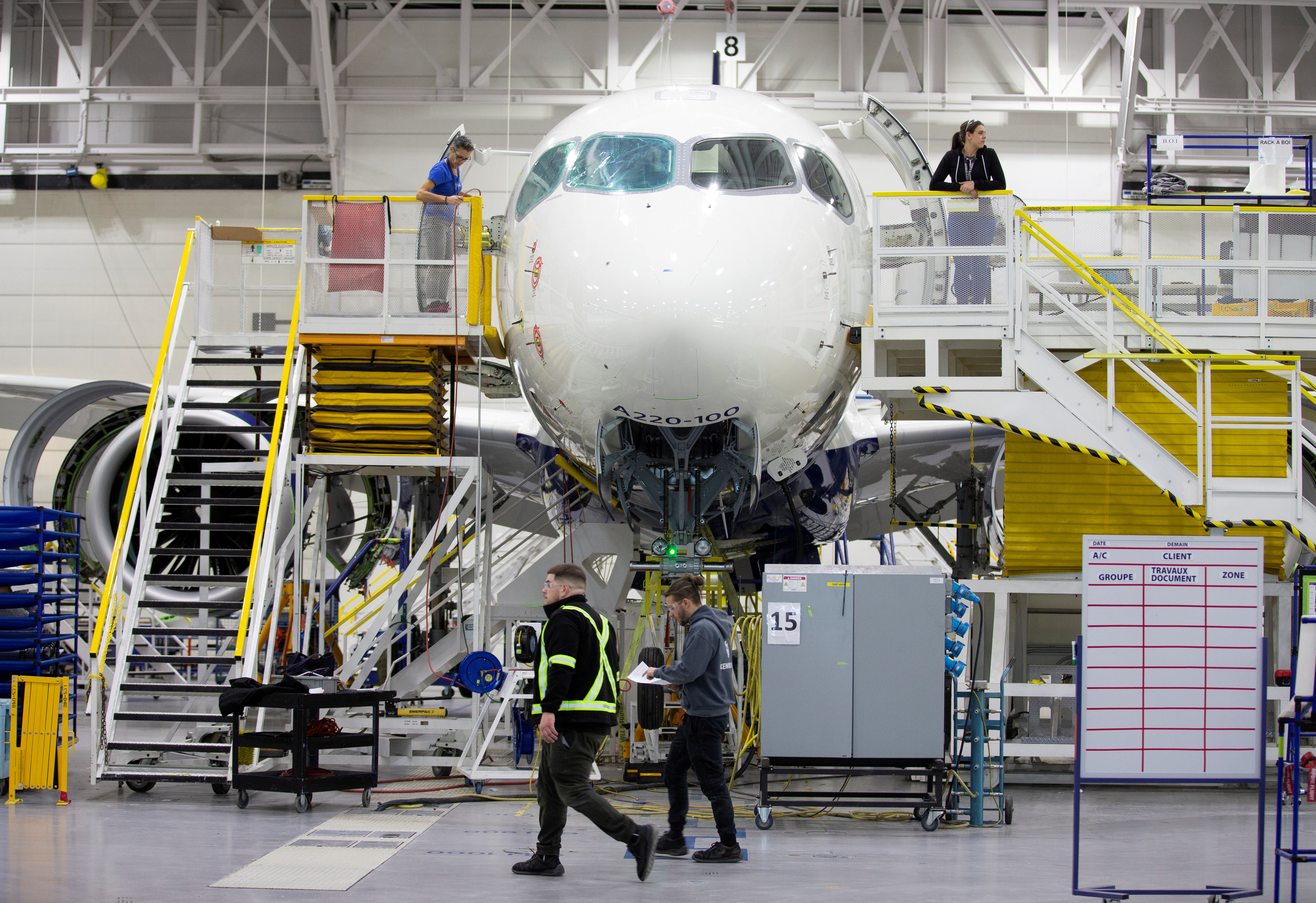 Employees work on an Airbus A220-300 at the Airbus facility in Mirabel, Quebec, Canada February 20, 2020.  REUTERS/Christinne Muschi