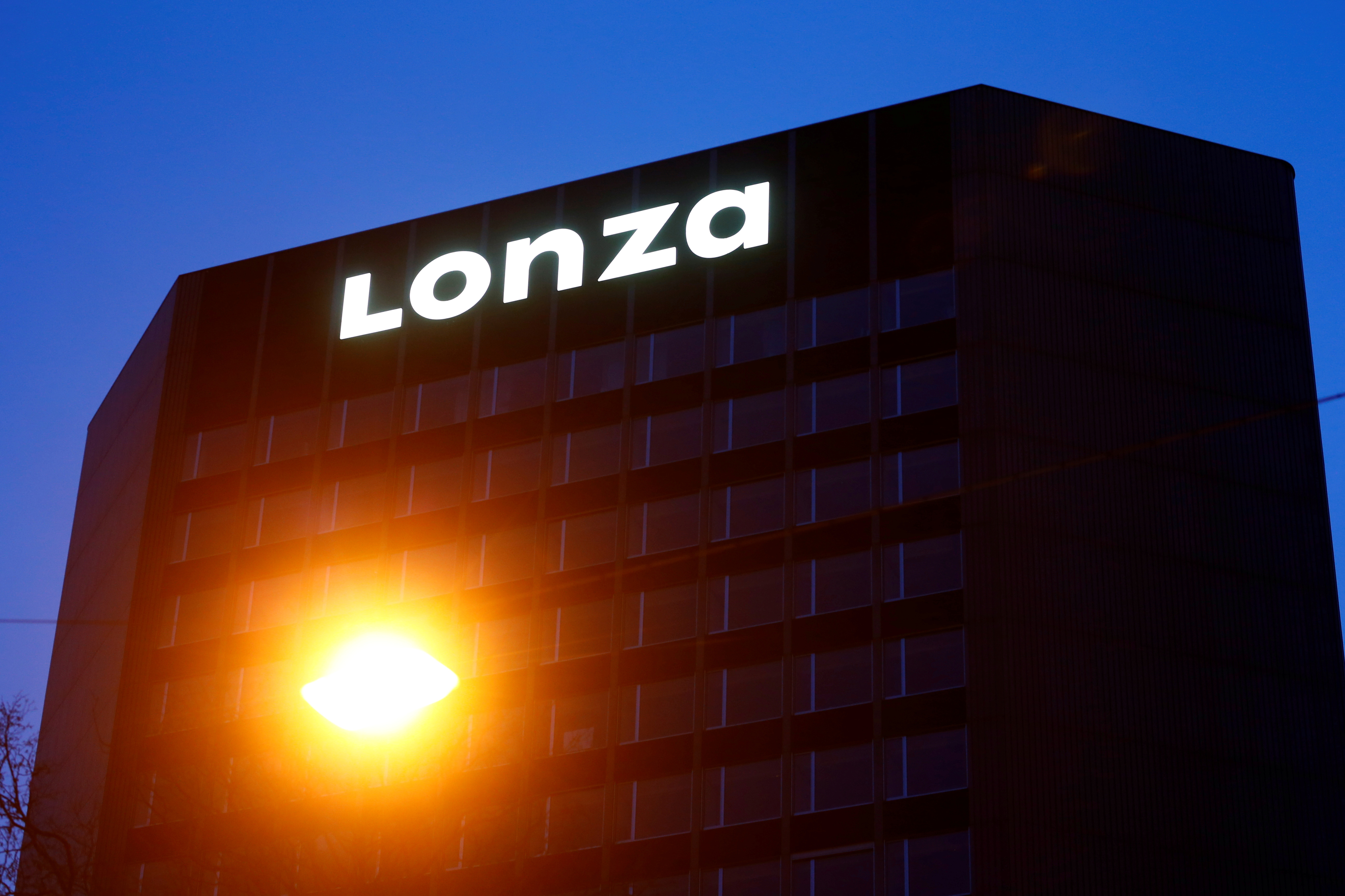 The logo of Swiss pharmaceutical group Lonza is seen at its headquarters in Basel, Switzerland March 2, 2020. REUTERS/Arnd Wiegmann