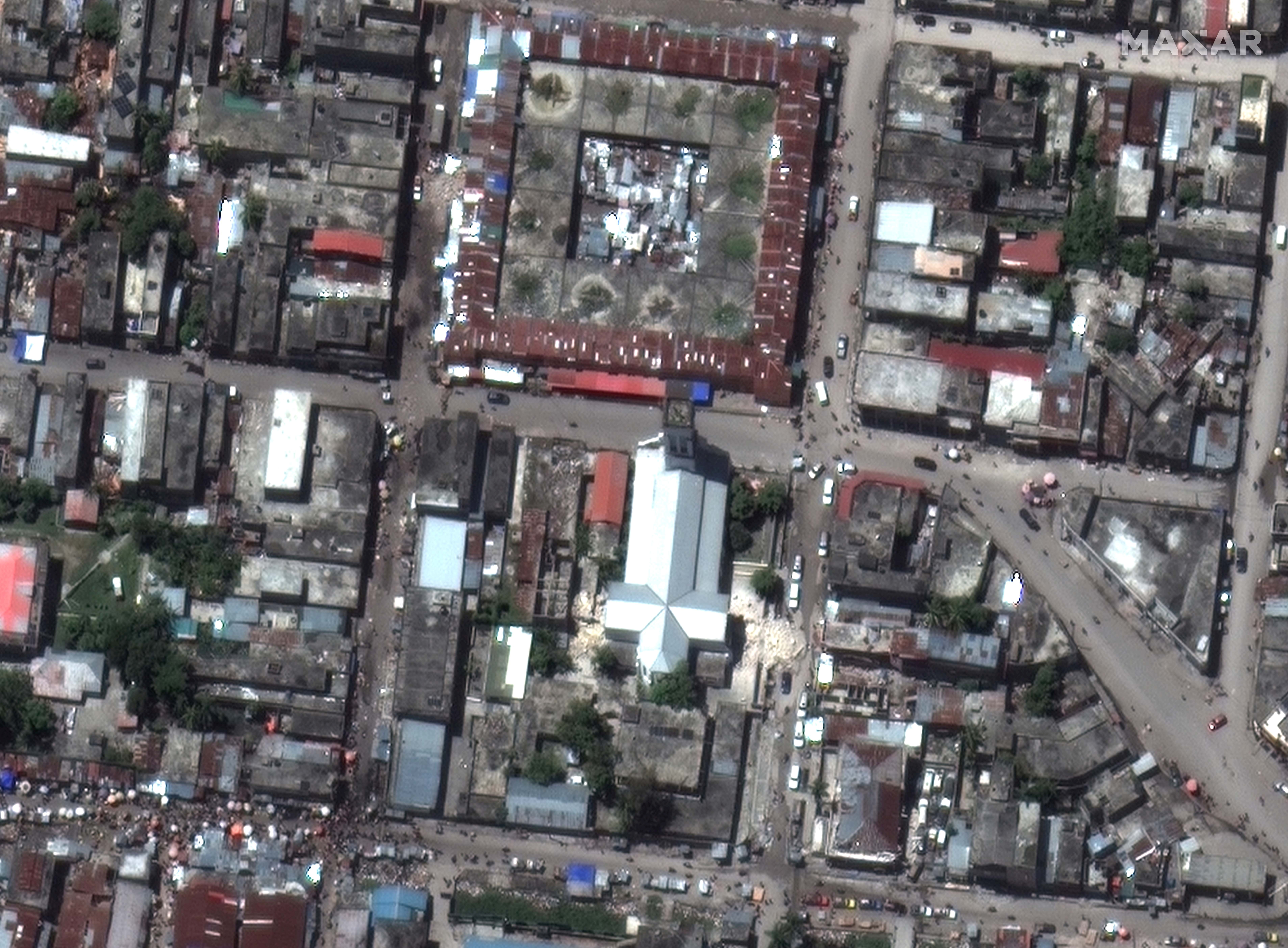 A satellite image shows the damaged Sacre Coeur des Cayes church in Les Cayes, after a 7.2 magnitude earthquake struck Haiti, August 15, 2021. SATELLITE IMAGE 2021 MAXAR TECHNOLOGIES/Handout via REUTERS