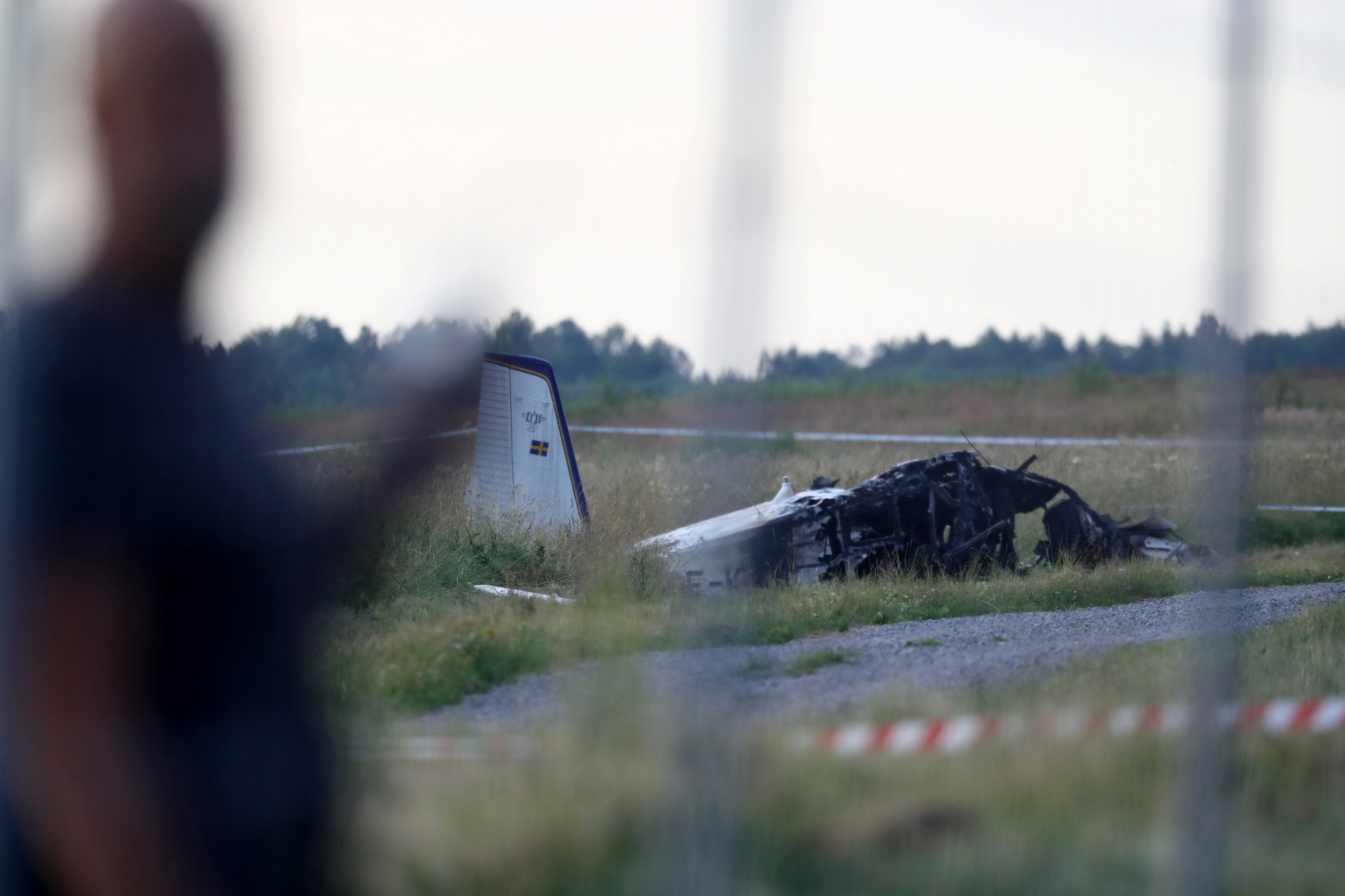 A small aircraft is seen after crashing at Orebro Airport, Orebro, Sweden,  July 8 2021.  TT News Agency/Jeppe Gustafsson via REUTERS