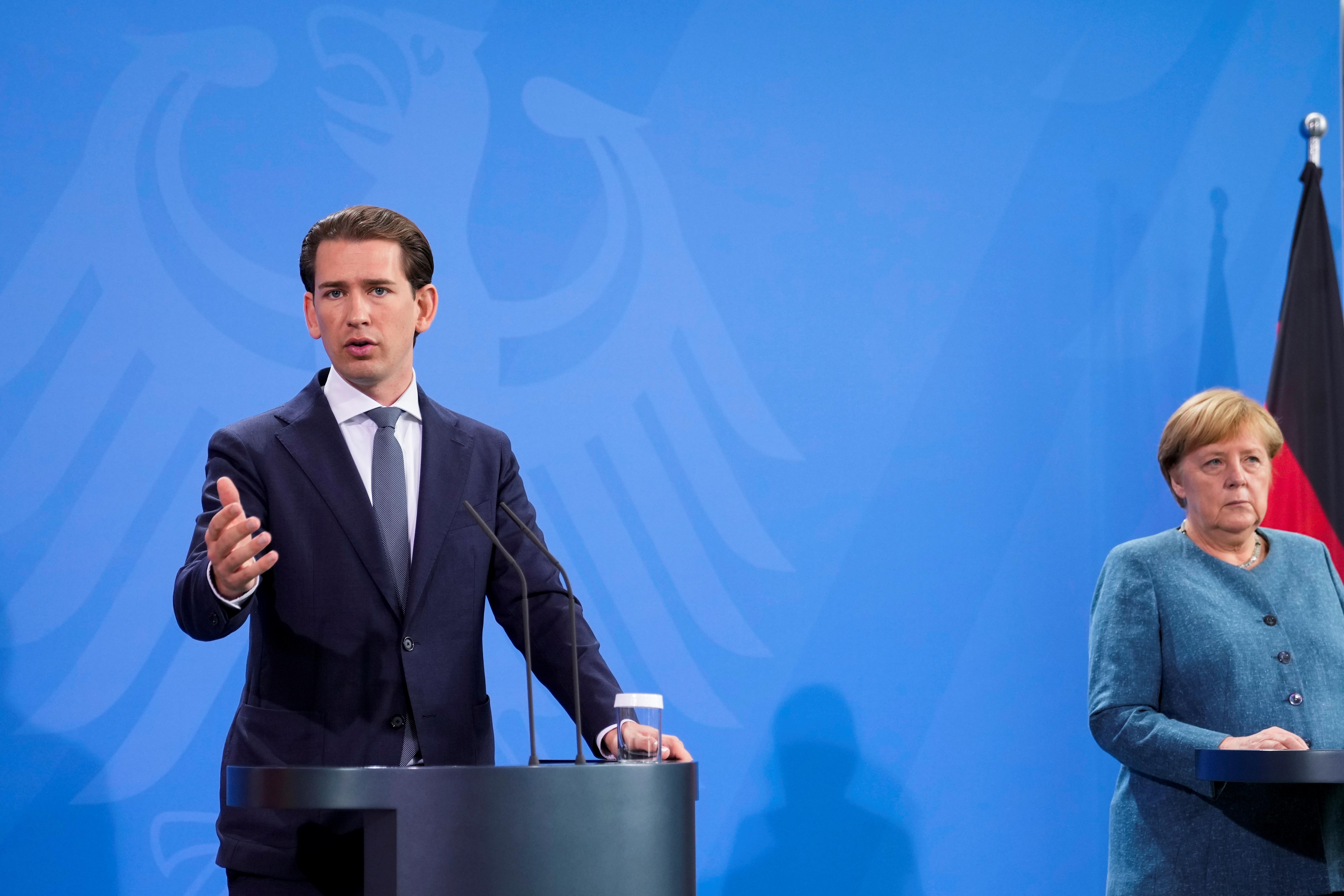 Η Γερμανίδα Καγκελάριος Άνγκελα Μέρκελ και ο Καγκελάριος της Αυστρίας Σεμπάστιαν Κουρτς παρευρίσκονται σε συνέντευξη Τύπου πριν από μια συνάντηση στην καγκελαρία στο Βερολίνο, Γερμανία 31 Αυγούστου 2021. Markus Schreiber/Pool via REUTERS