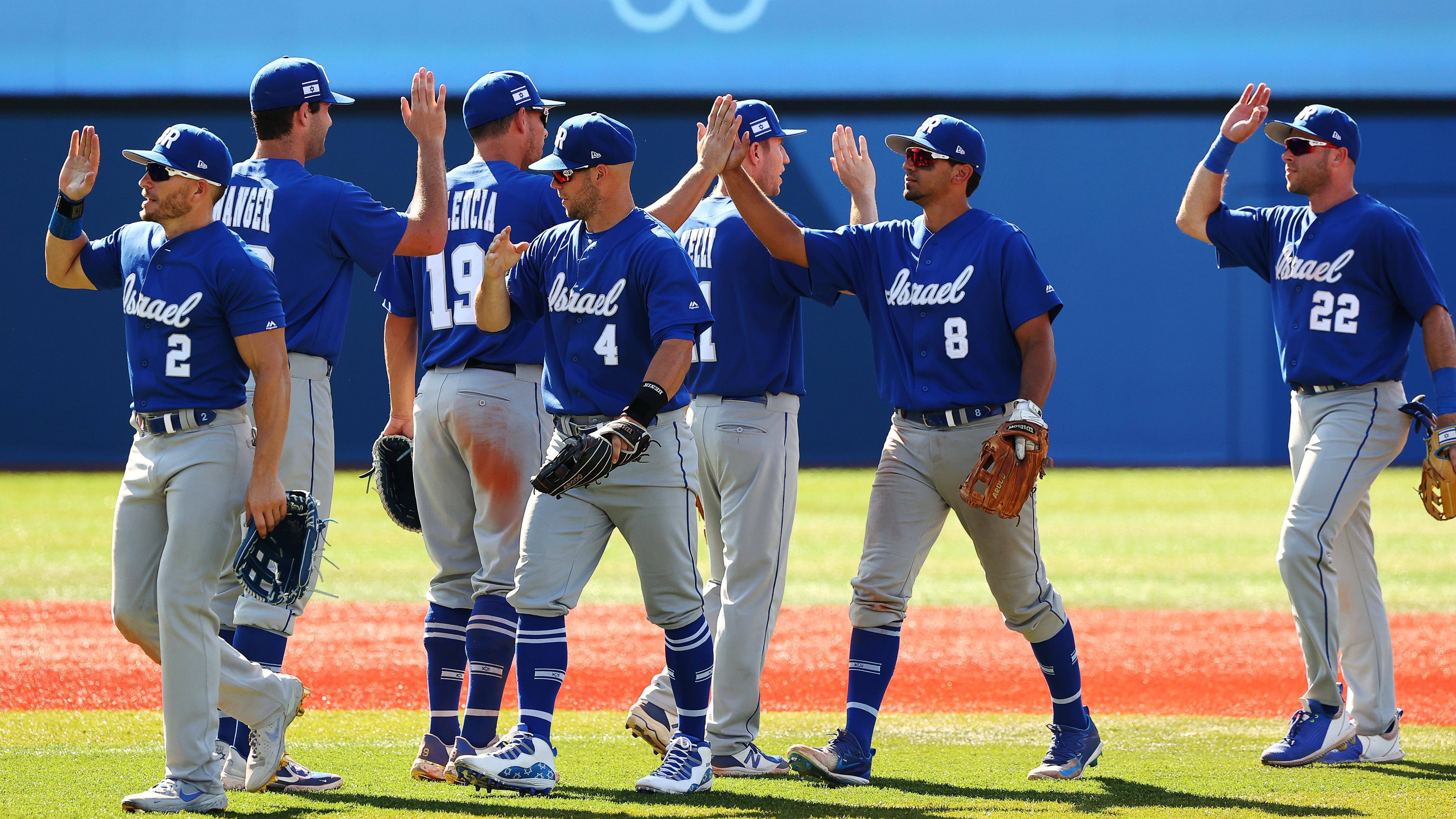Tokyo 2020 Olympics - Baseball - Men - Knockout Round 1 - Israel v Mexico - Yokohama Baseball Stadium, Yokohama, Japan - August 1, 2021. Israel players celebrate their win. REUTERS/Jorge Silva