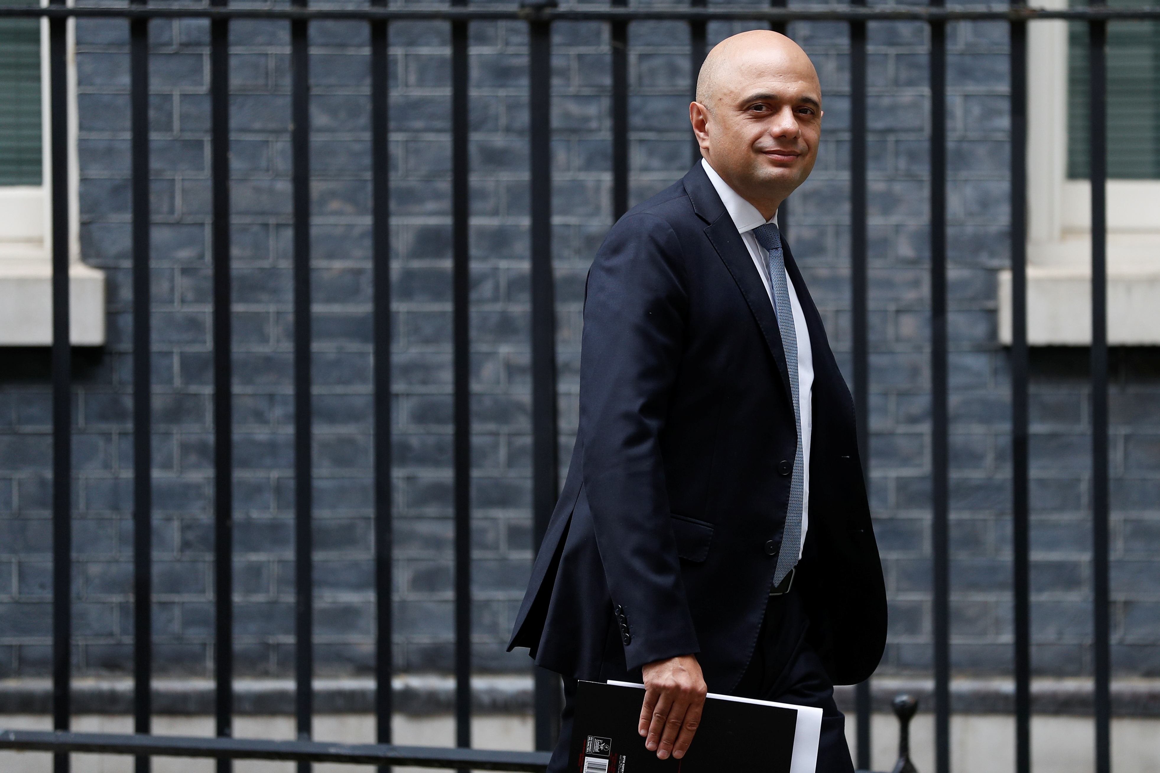 Health Secretary Sajid Javid walks on Downing Street in London, Britain, July 14, 2021. REUTERS/Peter Nicholls