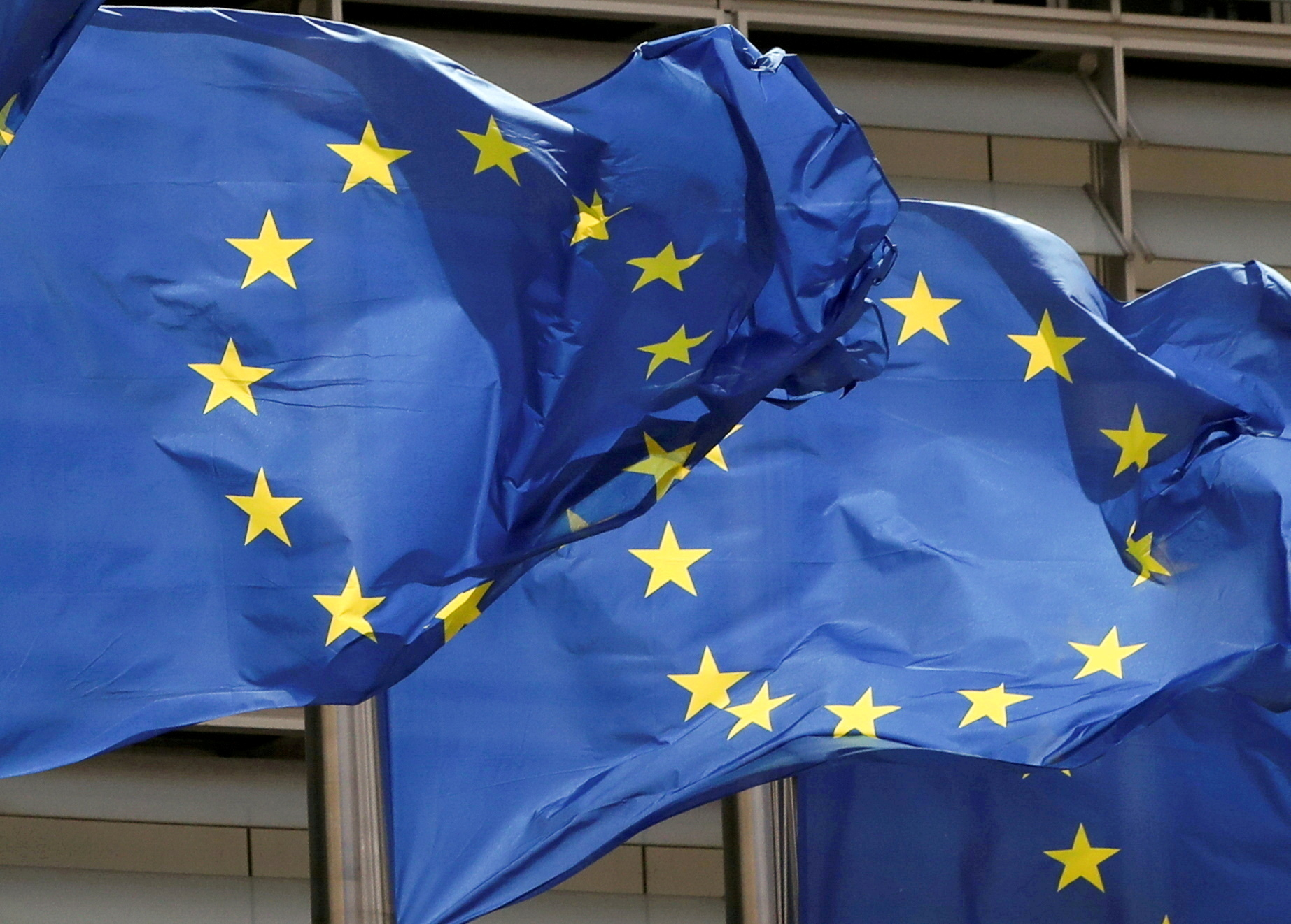 European Union flags flutter outside the EU Commission headquarters in Brussels, Belgium May 5, 2021. REUTERS/Yves Herman//File Photo