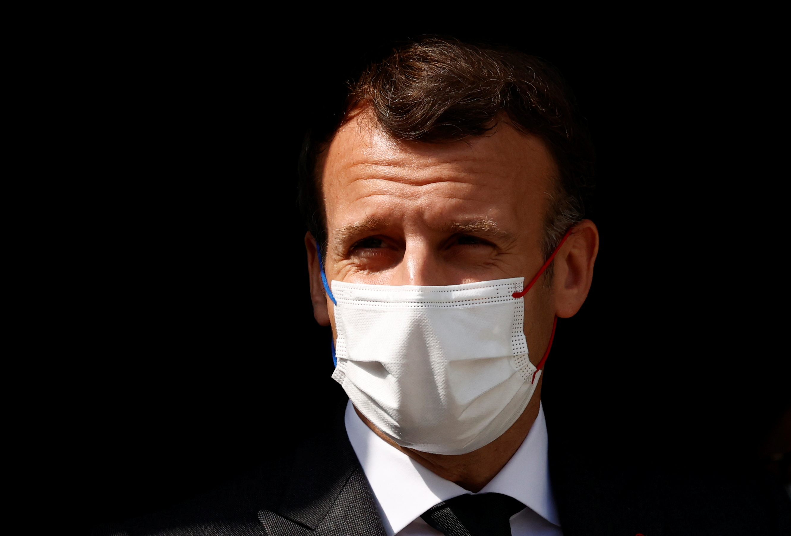 French President Emmanuel Macron, wearing a protective face mask, visits a child psychiatry department at Reims hospital to discuss the psychological impact of the COVID-19 crisis and the lockdown on children and teenagers in France, April 14, 2021.  REUTERS/Christian Hartmann/Pool