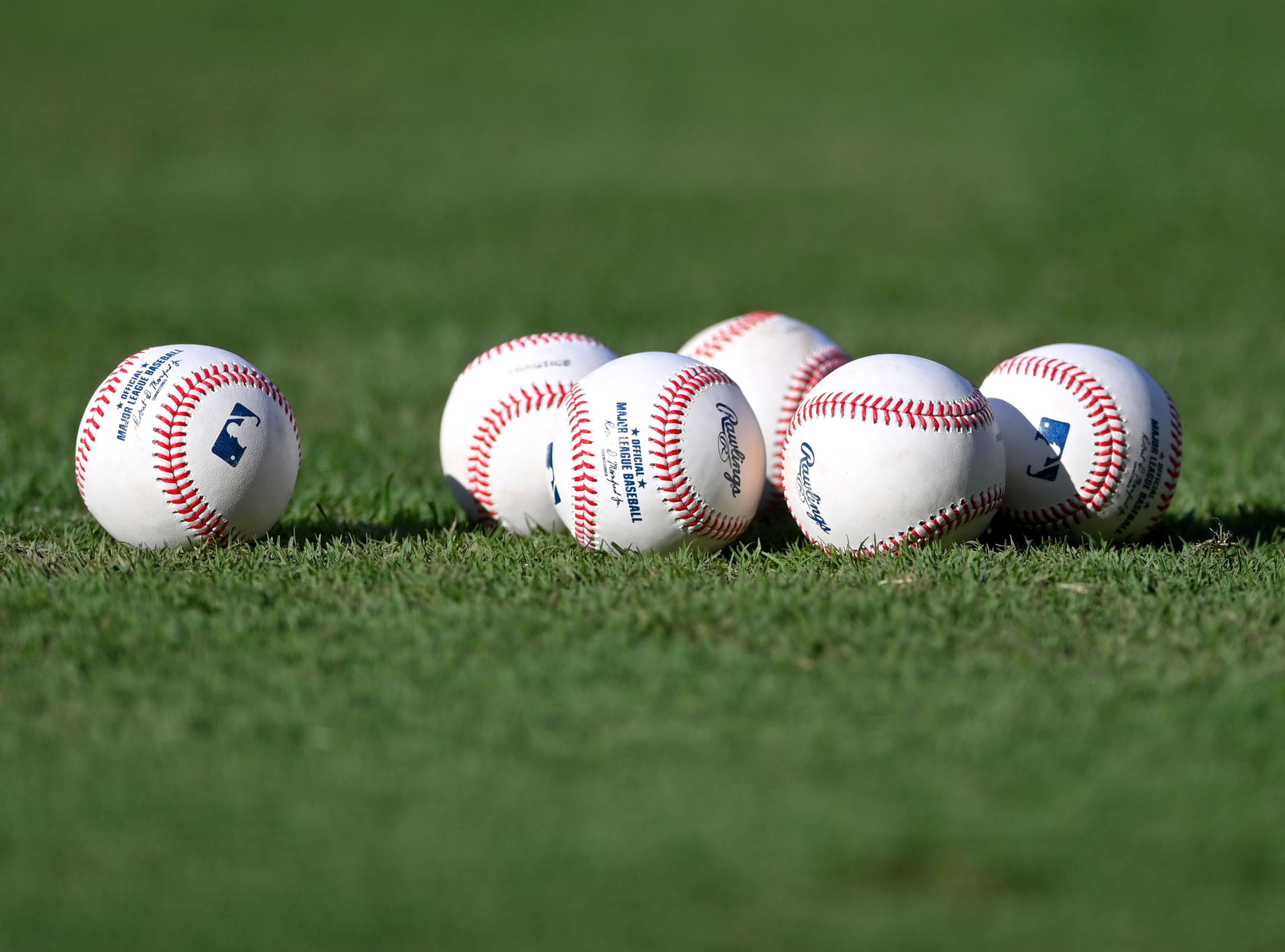Sep 20, 2021; Anaheim, California, USA; Detailed view of official Major League baseballs set on the grass before the game between the Los Angeles Angels and the Houston Astros at Angel Stadium. Mandatory Credit: Jayne Kamin-Oncea-USA TODAY Sports