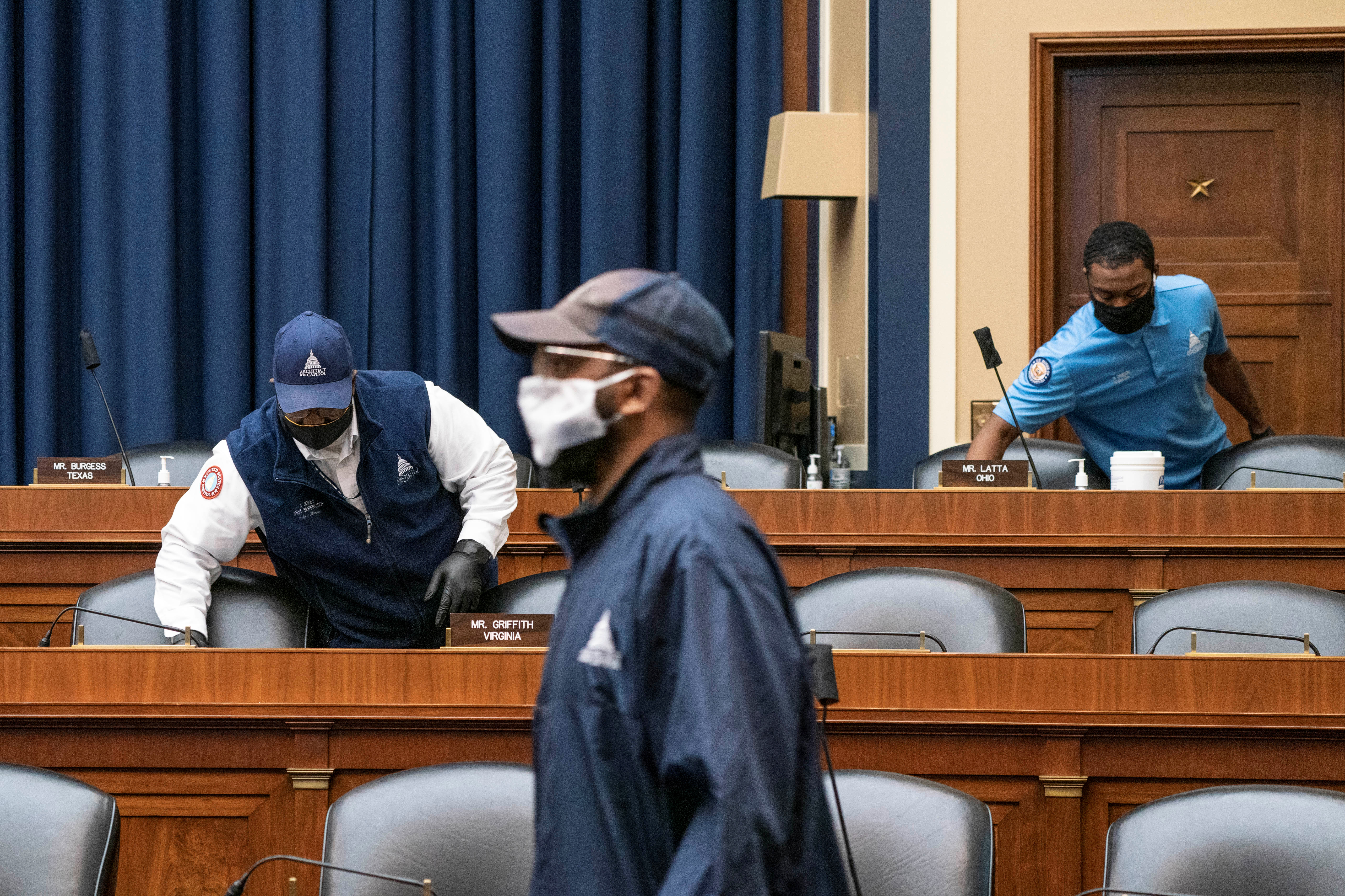 U.S. Capitol maintenance staff disinfect surfaces before the House Energy and Commerce Committee hearing on coronavirus in Washington, DC, U.S. June 23, 2020. Sarah Silbiger/Pool via REUTERS