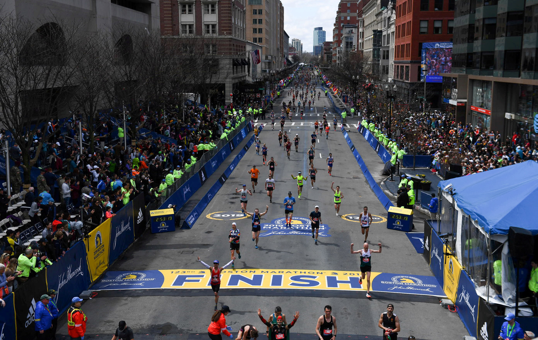Runners approach the finish line on Boylston Street during the 123rd Boston Marathon in Boston, Massachusetts, U.S., April 15, 2019. REUTERS/Gretchen Ertl/File Photo