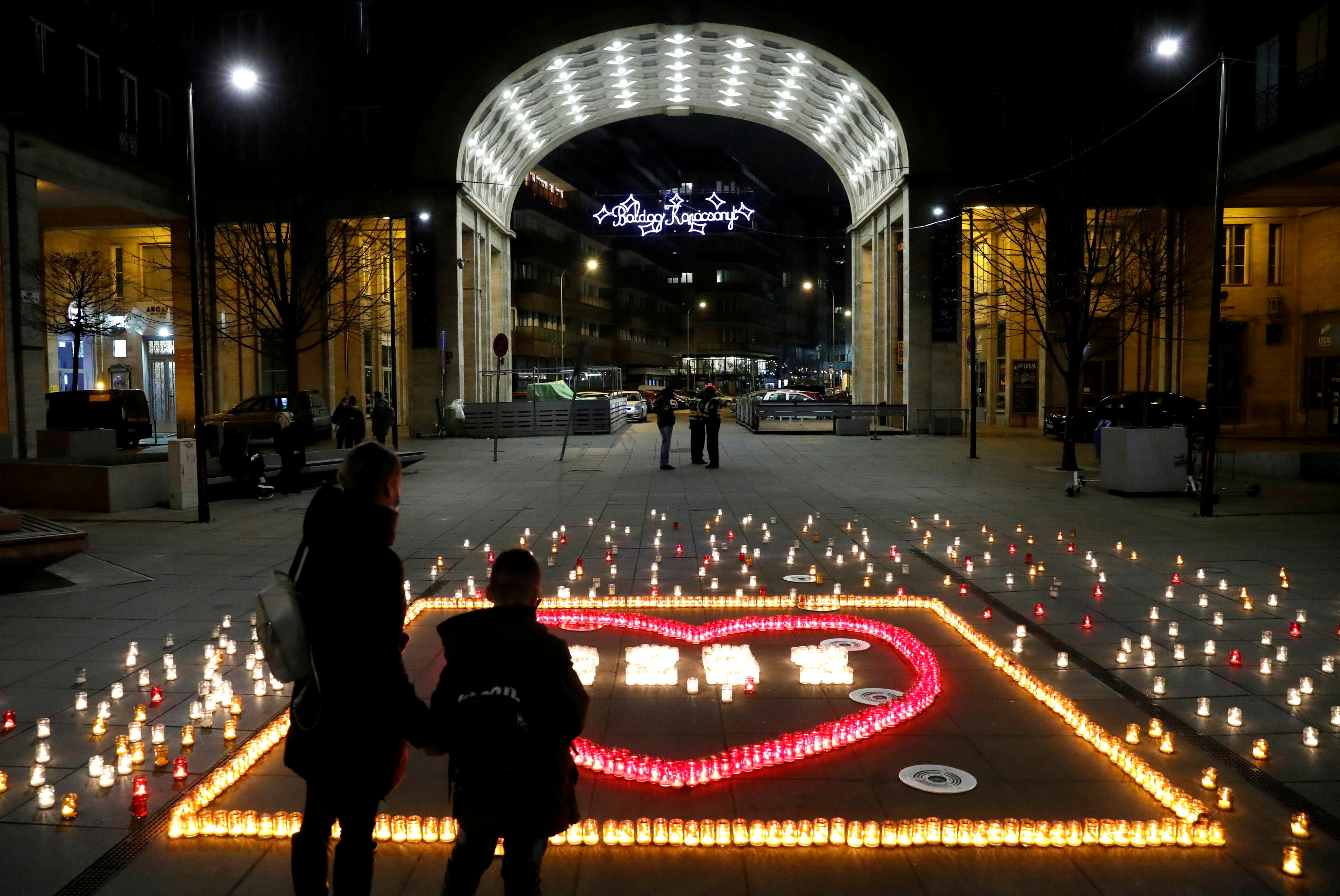 Candles are lit in memory of Hungary's coronavirus disease (COVID-19) victims in Budapest, Hungary, December 21, 2020. REUTERS/Bernadett Szabo/File Photo