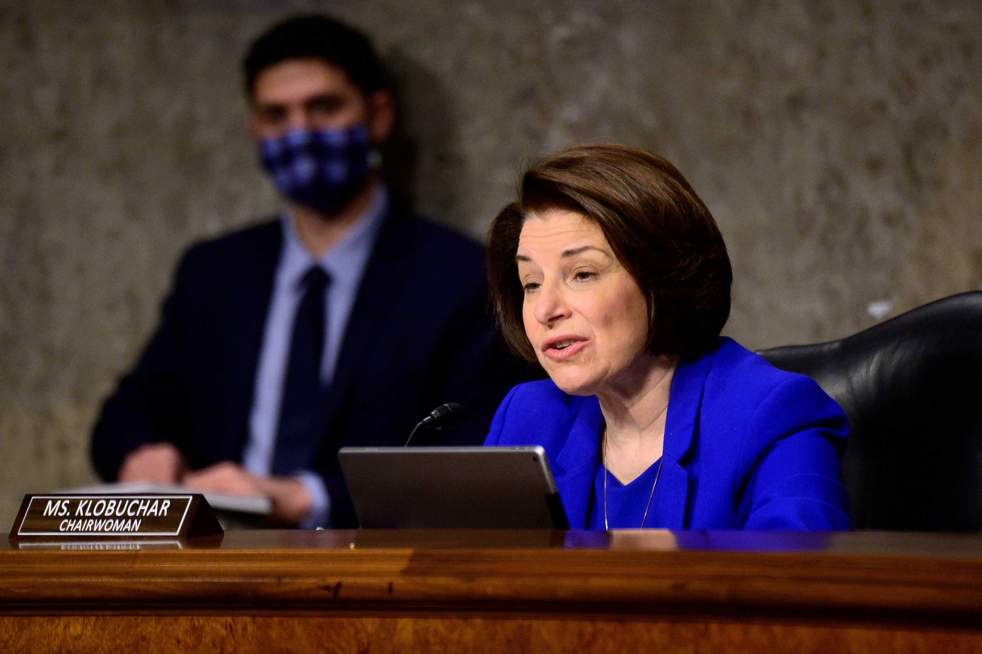 Chairwoman Amy Klobuchar, D-Minn., speaks during a Senate Homeland Security and Governmental Affairs and Senate Rules and Administration committees joint hearing on Capitol Hill, Washington, U.S. February 23, 2021, Erin Scott/Pool via REUTERS