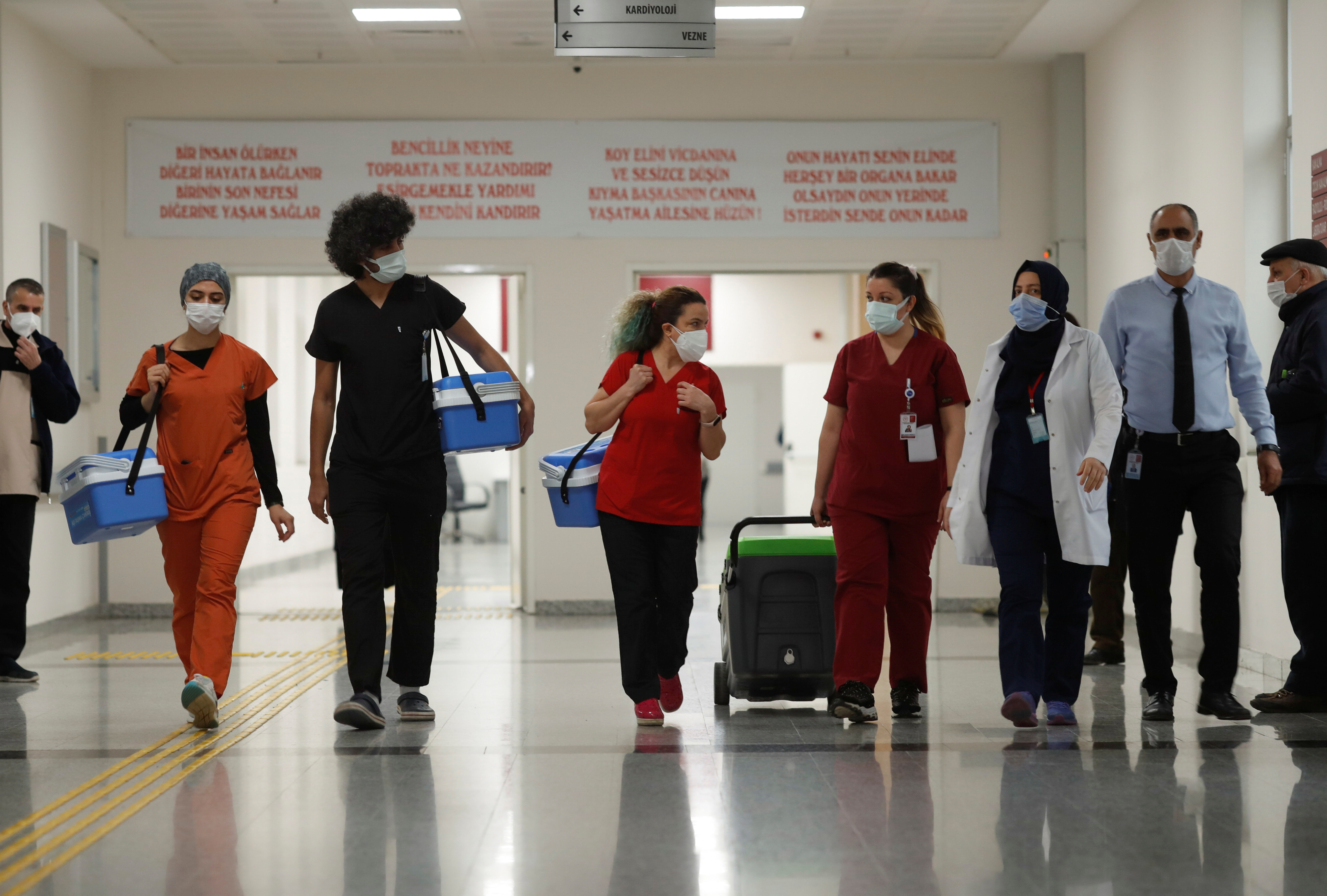 Health workers carry Sinovac's CoronaVac COVID-19 vaccine boxes at Sancaktepe Sehit Dr. Ilhan Varank Training and Research Hospital, in Istanbul, Turkey January 14, 2021. REUTERS/Murad Sezer