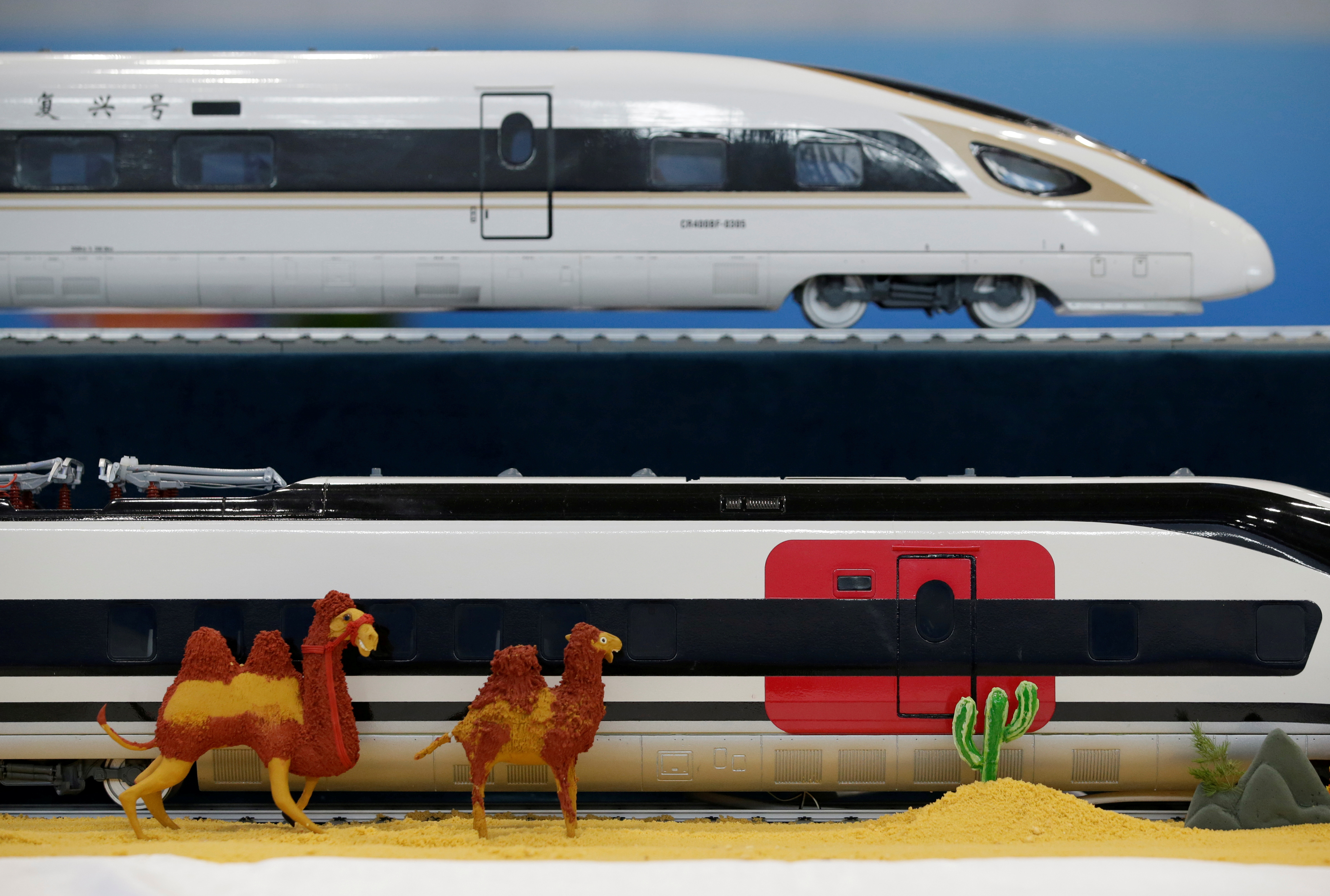 A replica of China Railway High-speed trains is seen at a media center for the second Belt and Road Forum, in Beijing, China, April 26, 2019. REUTERS/Jason Lee/File Photo