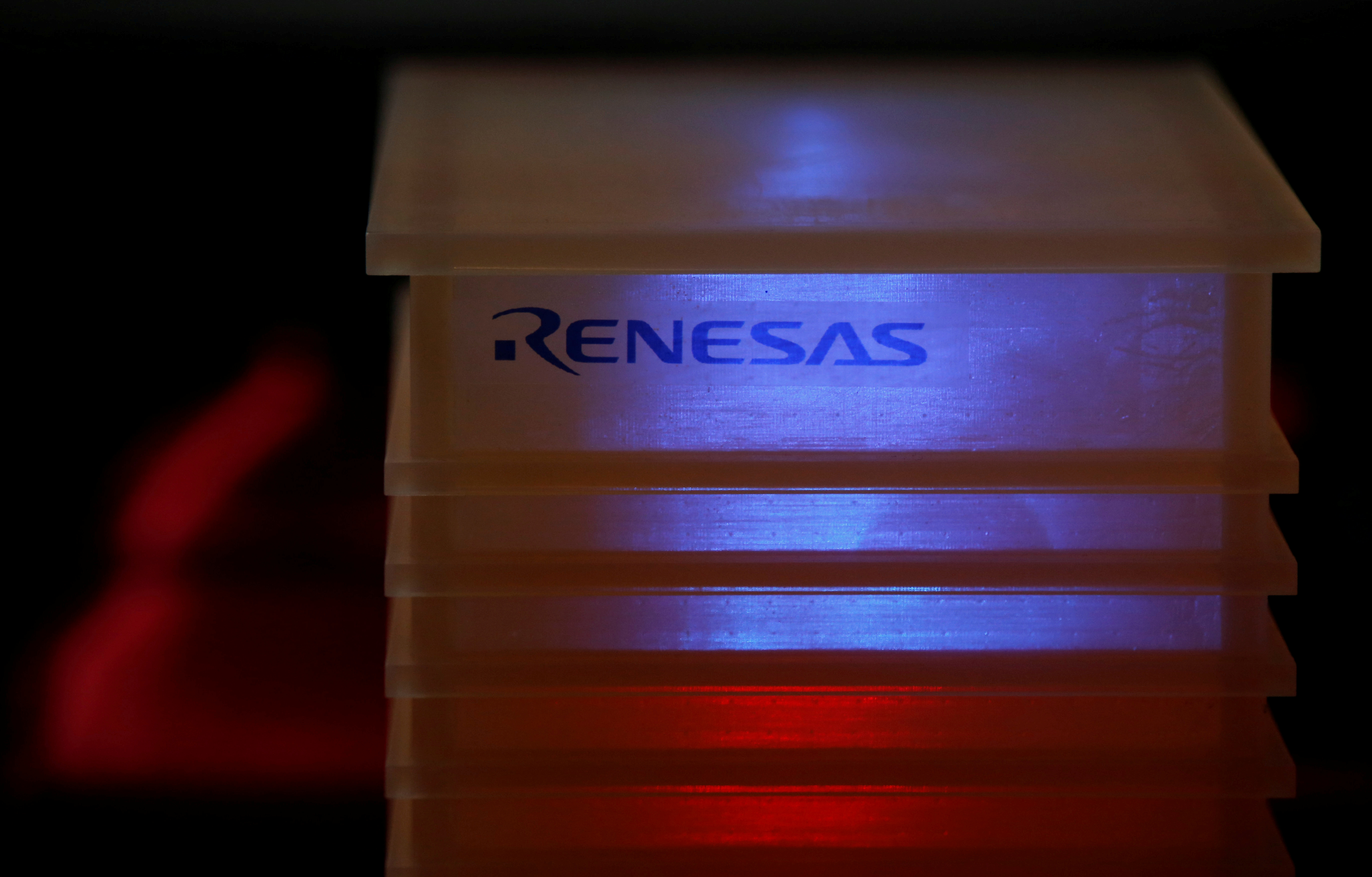 Renesas Electronics Corp's logo is seen at a company conference in Tokyo, Japan, April 11, 2017. REUTERS/Toru Hanai
