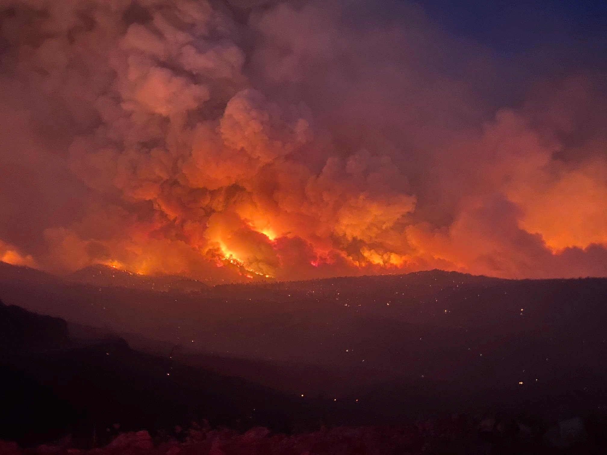 Smoke plumes rise from a blaze as a wildfire rages on in Arizona, U.S., June 7, 2021, in this image obtained from social media. Arizona Department of Forestry and Fire Management/ via REUTERS