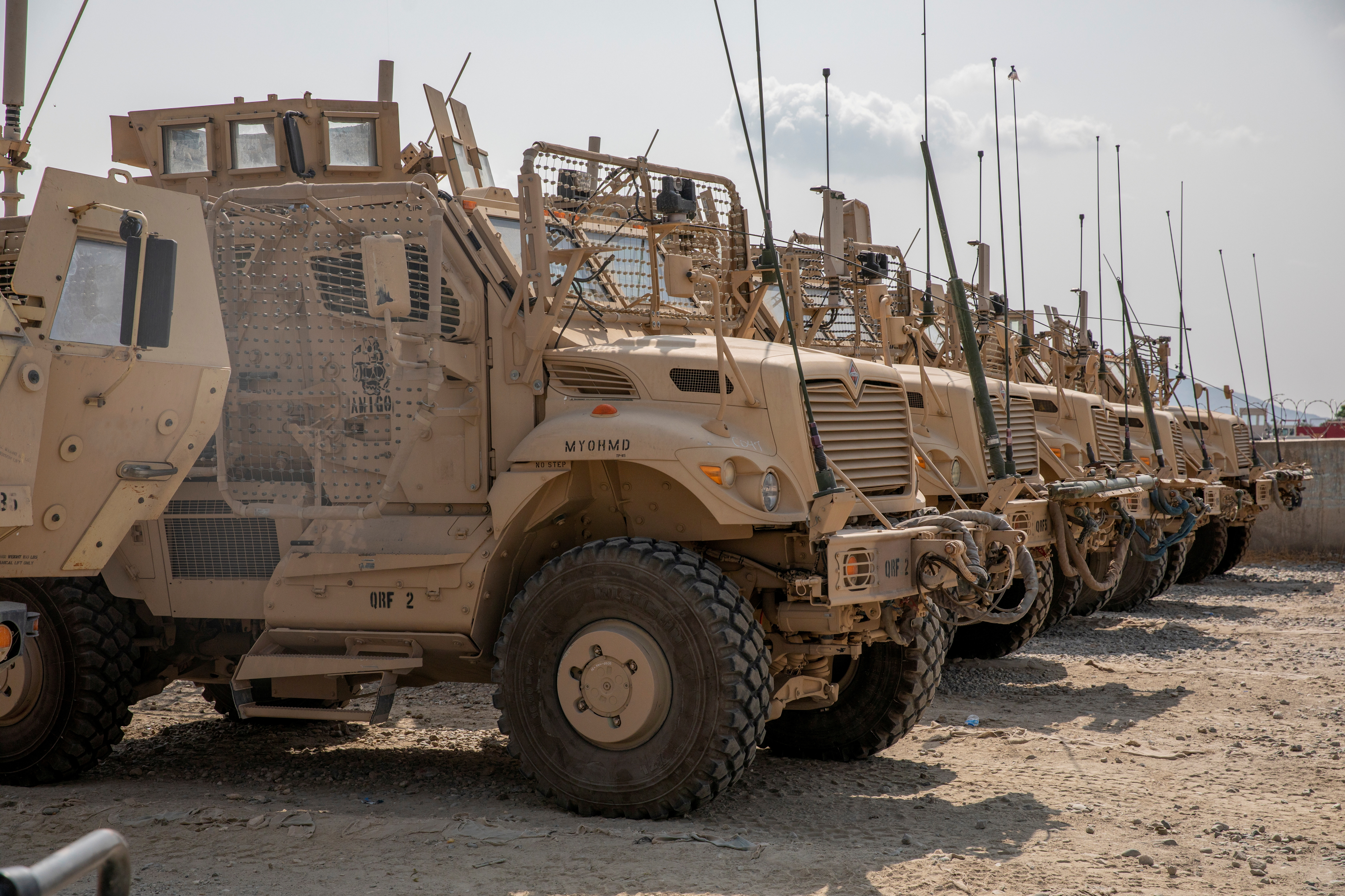 U.S. Army soldiers from the 10th Mountain Division and U.S. contractors prepare Mine Resistant Ambush Protected vehicles, MRAPs, to be transported off of base in support of the withdrawal mission in Kandahar, Afghanistan, August 21, 2020. Picture taken August 21, 2020. U.S. Army/Sgt. Jeffery J. Harris/Handout via REUTERS