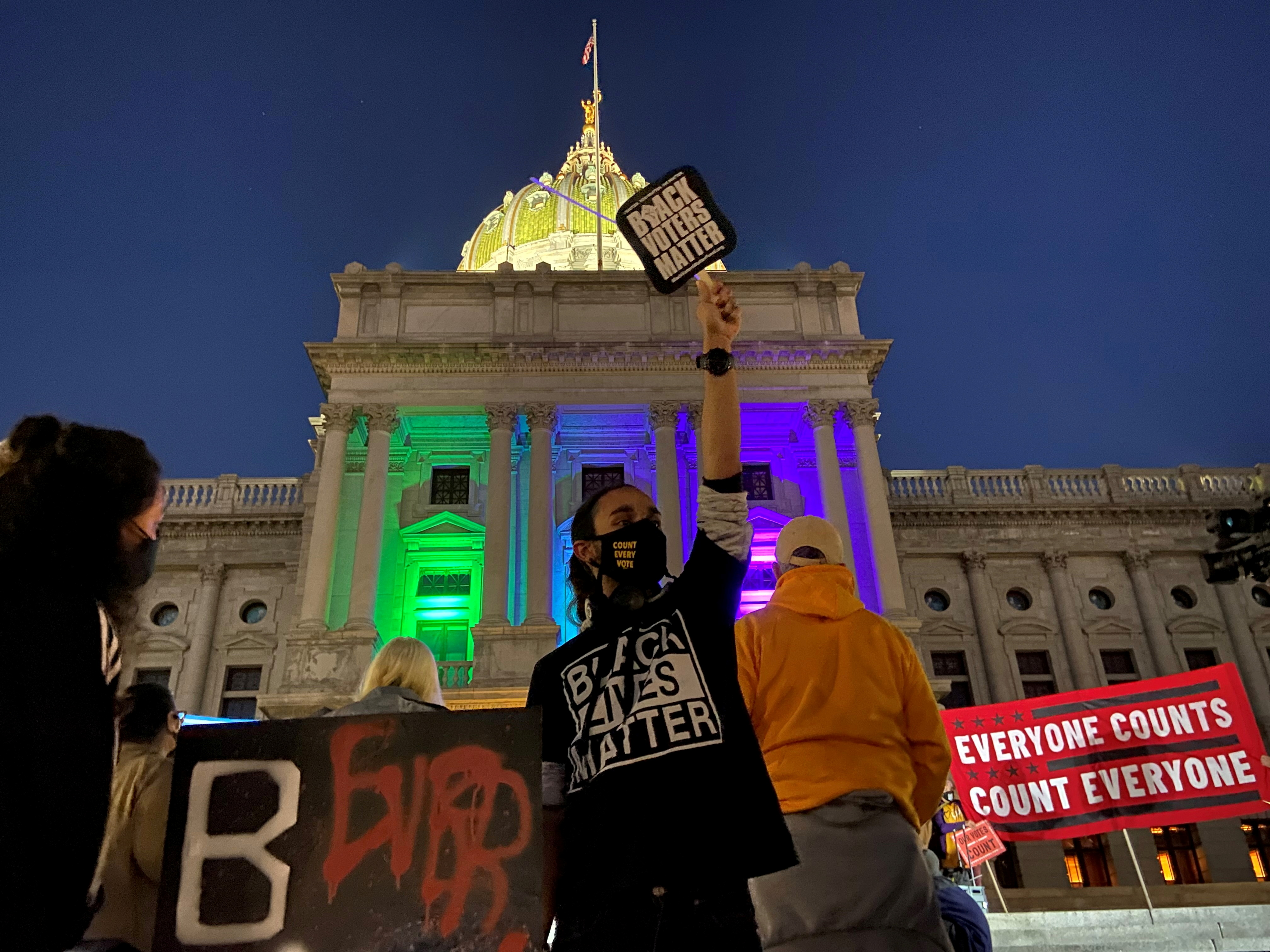 Angel Rivera, a 20-year-old bartender, holds a Black Voters Matter sign during a rally at the Pennsylvania State Capitol Building to protest attempts to halt the counting of ballots cast in the state for the 2020 presidential election, in Harrisburg, Pennsylvania November 4, 2020. REUTERS/Nathan Layne/File Photo