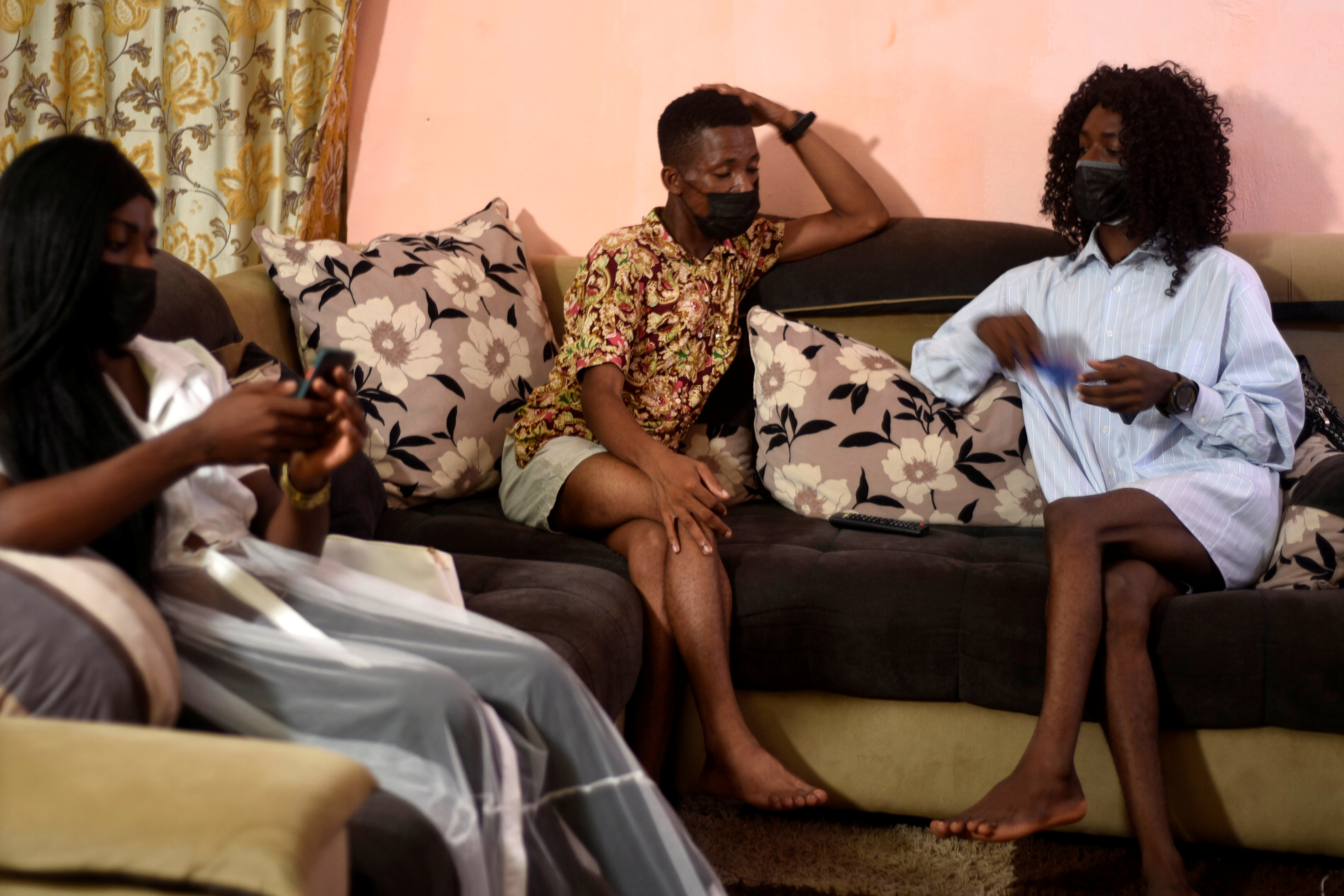 Transgender women Lumiere, 24, Blanche Bailli, 26 and Shakira visit their friend Nkwain Hamlet, a gay-rights activist in Douala, Cameroon April 24, 2021.   REUTERS/Chantal Edie