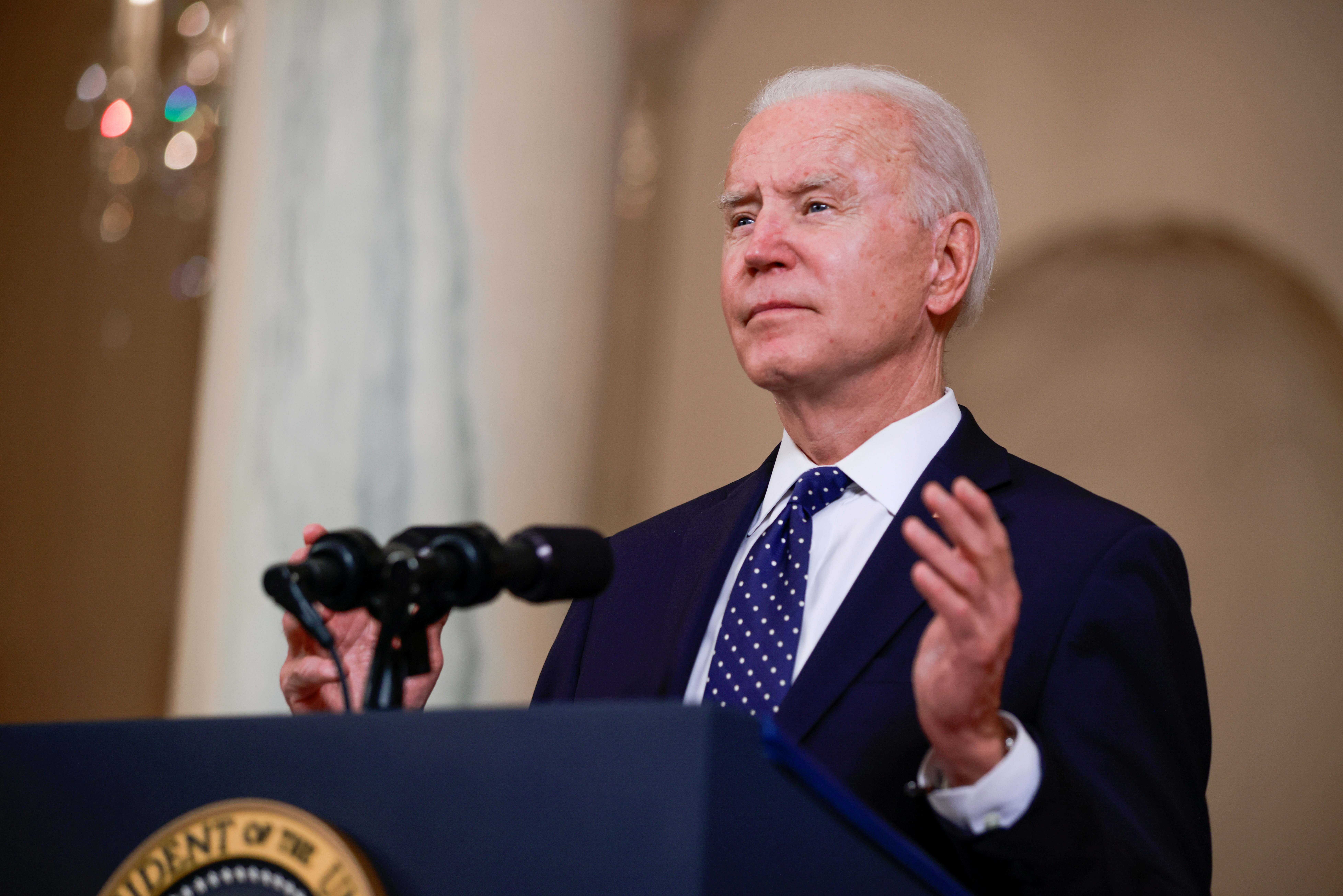 U.S. President Joe Biden speaks in the Cross Hall at the White House in Washington, U.S., April 20, 2021. REUTERS/Tom Brenner/File Photo