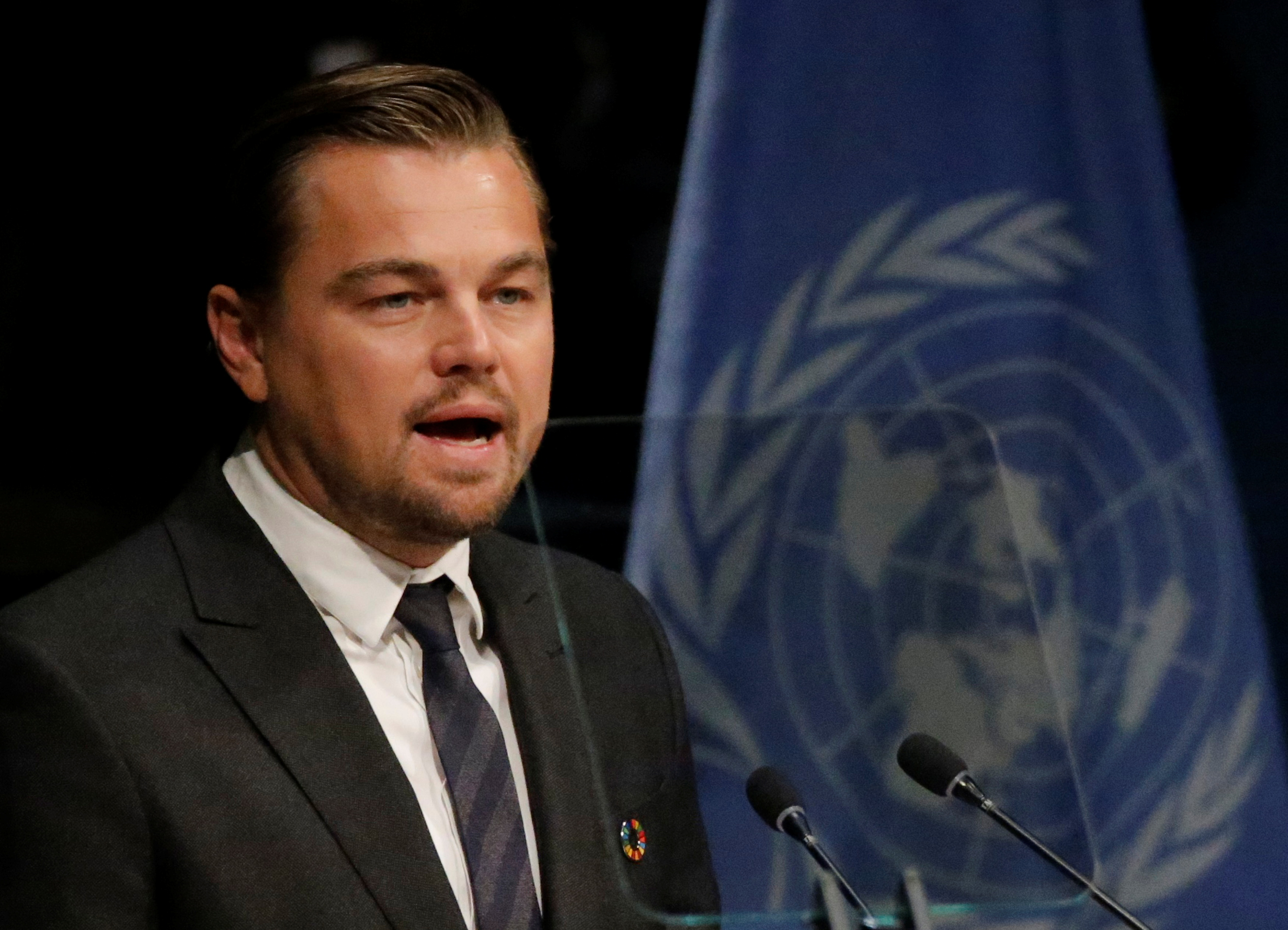Actor Leonardo DiCaprio delivers his remarks during the Paris Agreement on climate change held at the United Nations Headquarters in Manhattan, New York, U.S., April 22, 2016.  REUTERS/Carlo Allegri
