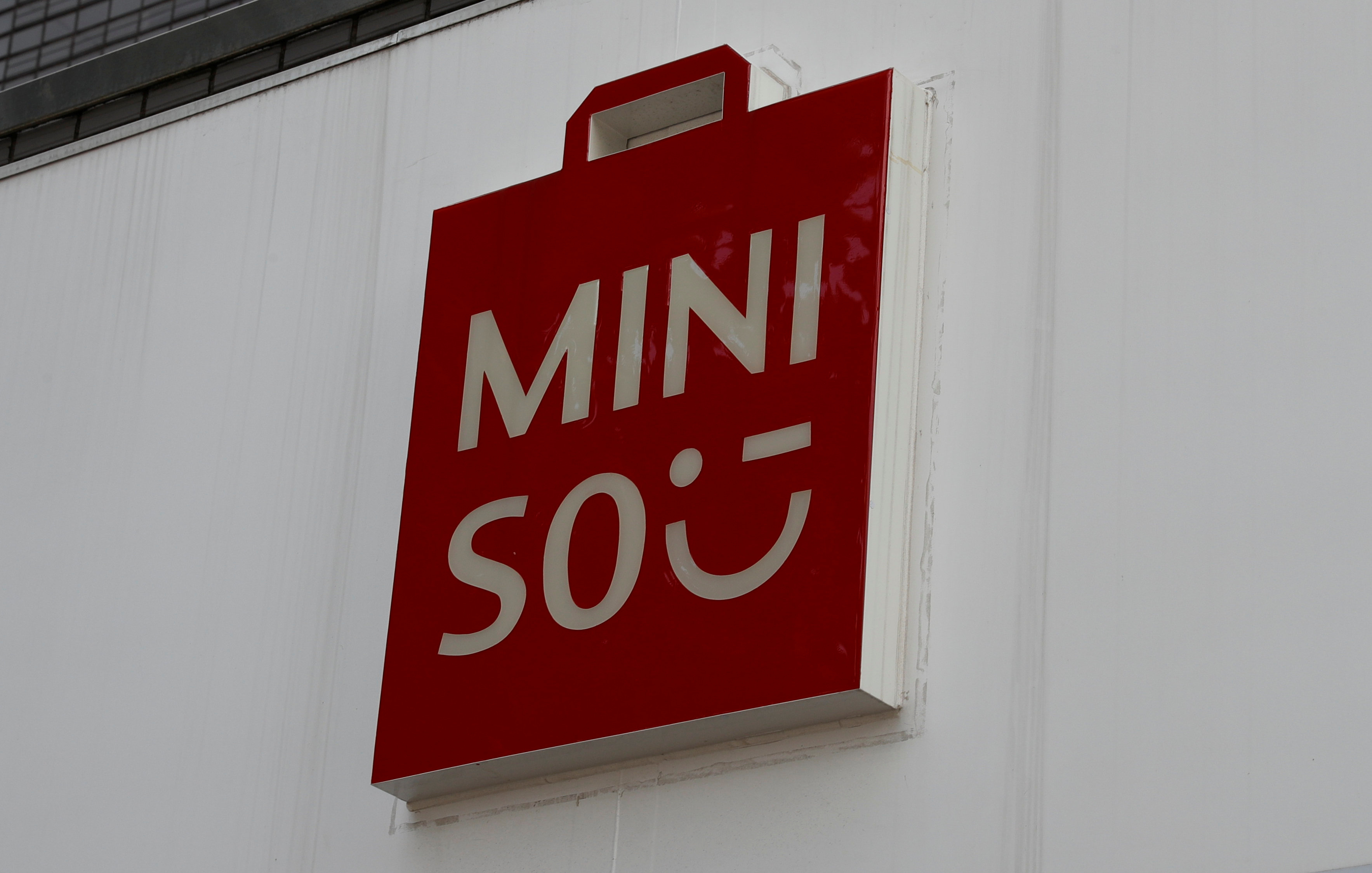 The logo of Chinese low-cost lifestyle and consumer products retailer Miniso is pictured in Tokyo, Japan August 10, 2018. REUTERS/Kim Kyung-Hoon