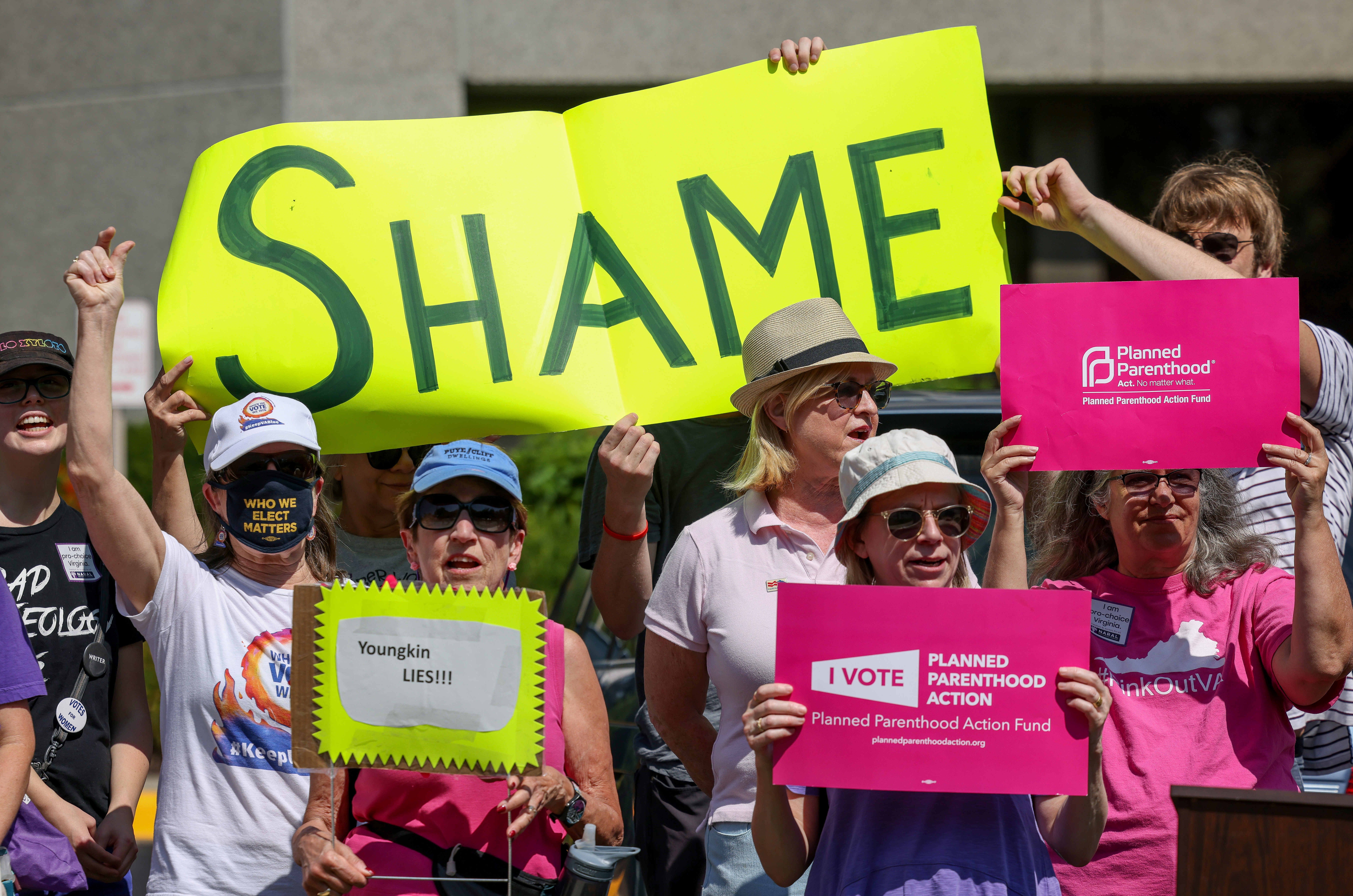 Demostrators protest outside of a campaign event for Virginia gubernatorial candidate Glenn Youngkin (R-VA), in McLean, Virginia, U.S., July 14, 2021. REUTERS/Evelyn Hockstein