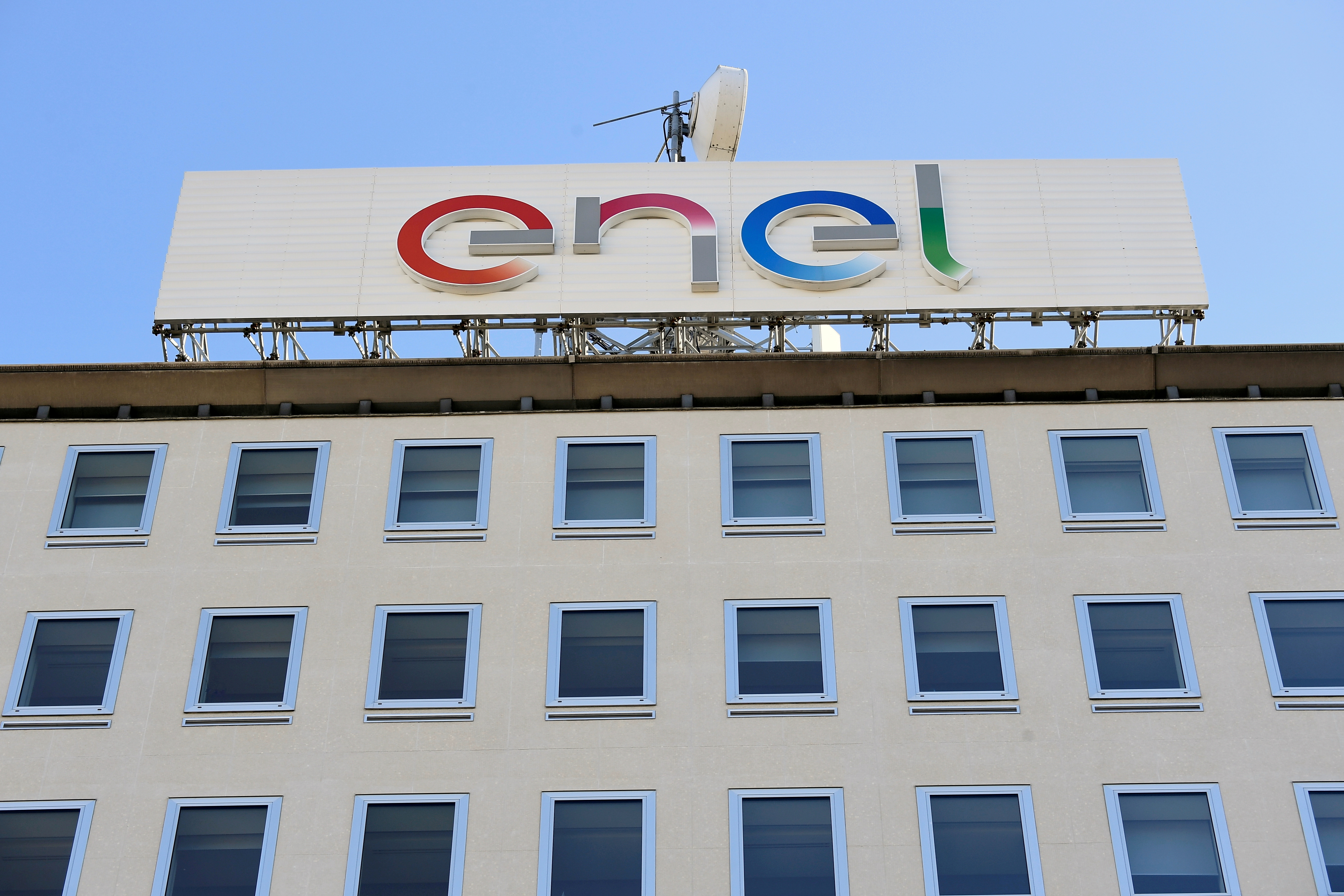 A logo of Italian multinational energy company Enel is seen at the Milan headquarters, Italy, February 5, 2020. REUTERS/Flavio Lo Scalzo/File Photo