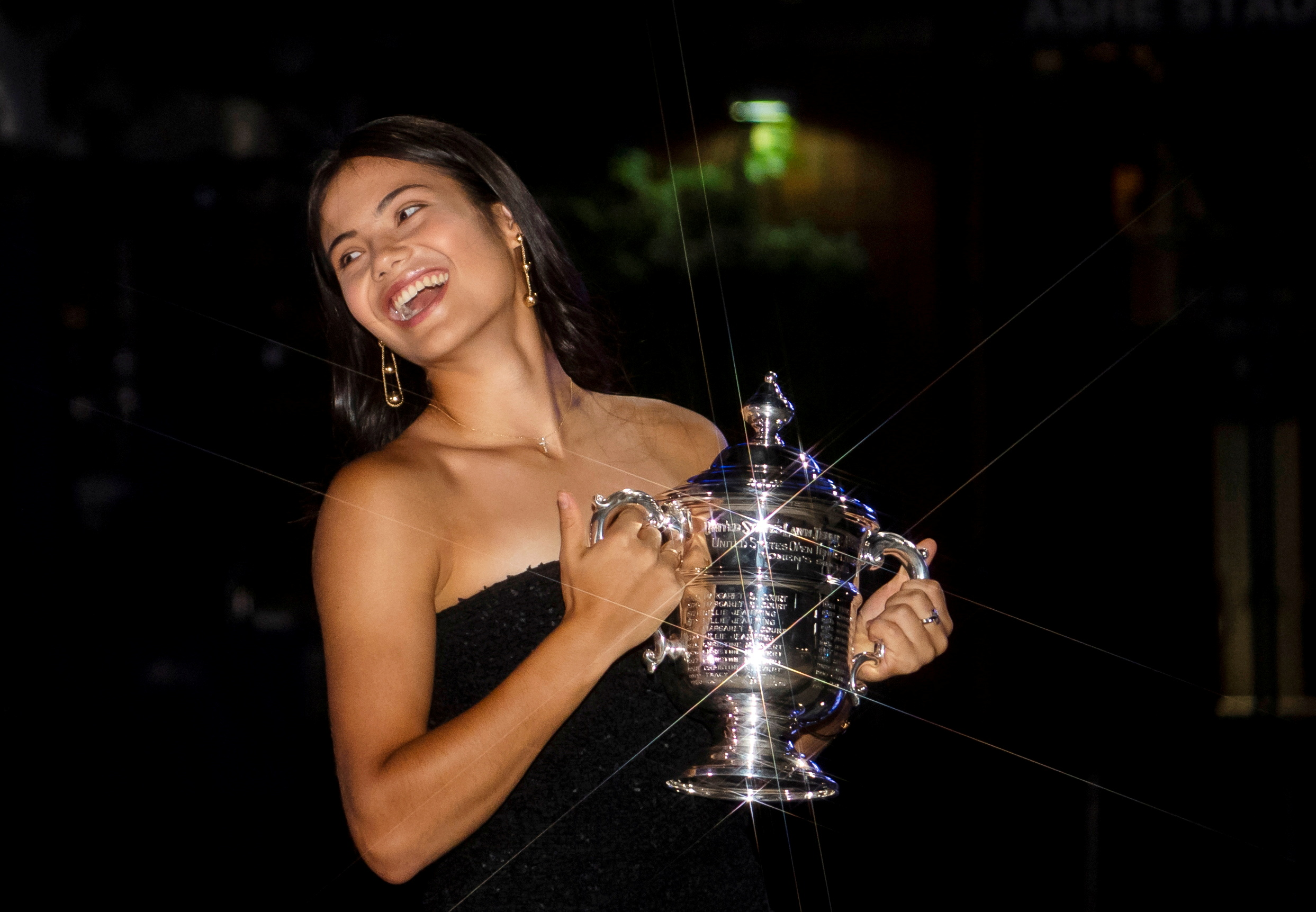 Britain's Emma Raducanu poses with the U.S. Open tennis championship trophy after her match against Leylah Fernandez of Canada in the women's singles final the 2021 U.S. Open tennis tournament at USTA Billie Jean King National Tennis Center in New York, U.S., September 11, 2021. Picture taken September 11, 2021.   Michael Frey/Handout via REUTERS