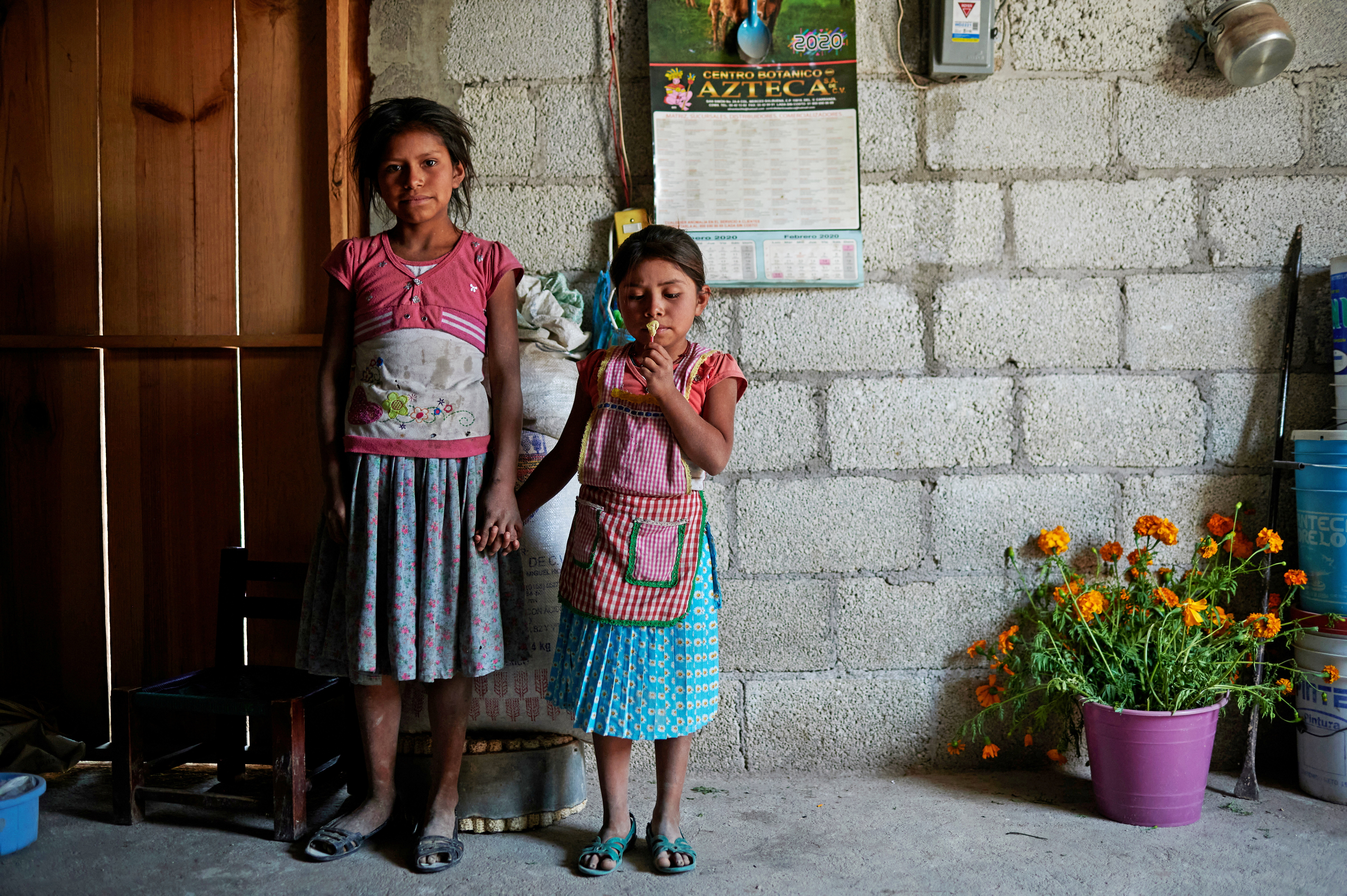 Children of the Nahua indigenous community of Alcozacan are seen in their house, before a demonstration by children carrying replicas of toy and wooden weapons, in the town of Alcozacan, Guerrero state , Mexico April 29, 2021. REUTERS /Mahe Elipe TPX IMAGES OF THE DAY