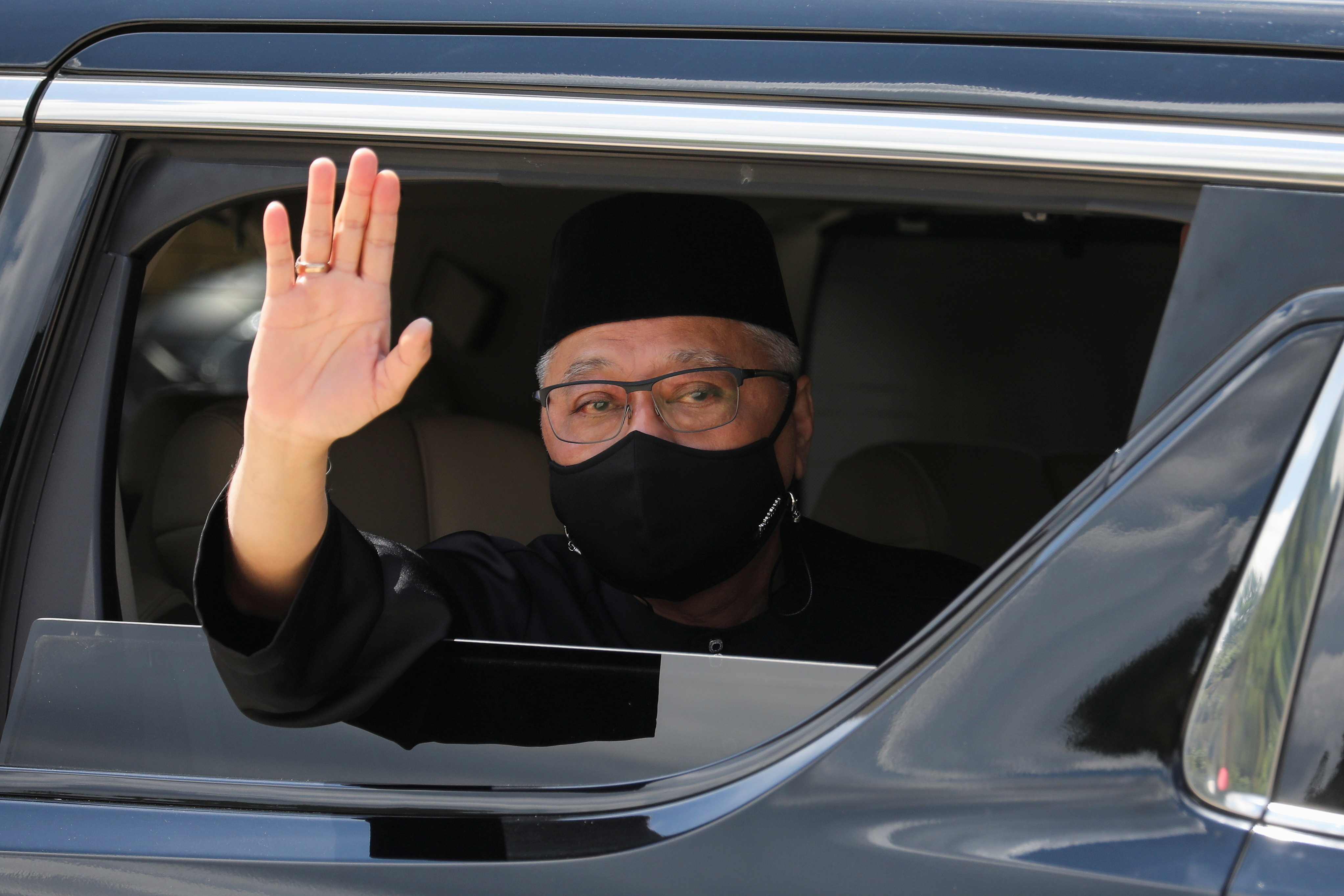 New Malaysian Prime Minister Ismail Sabri Yaakob waves from a car, as he leaves after the inauguration ceremony, in Kuala Lumpur, Malaysia August 21, 2021. REUTERS/Lim Huey Teng/File Photo